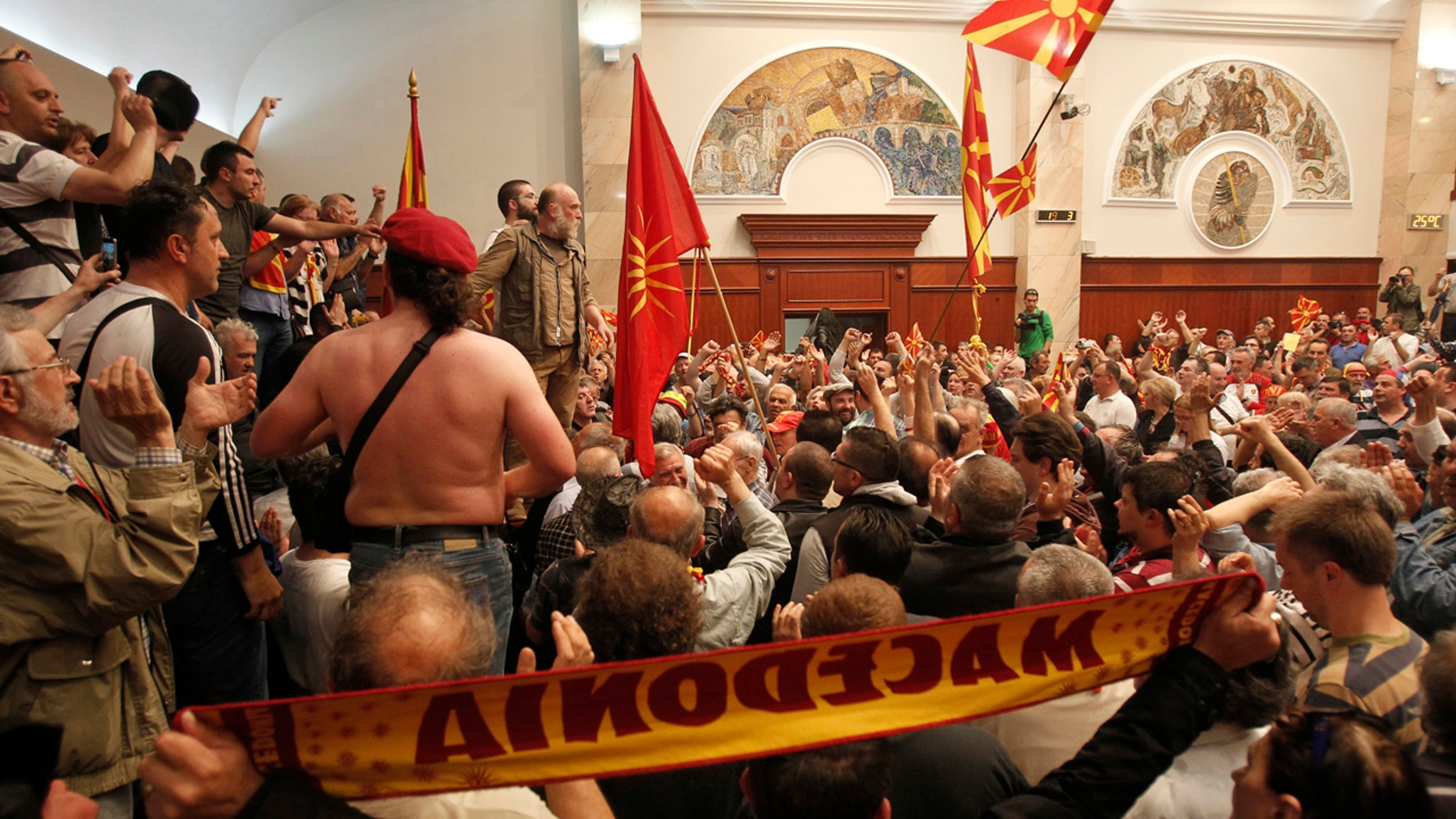 Protesters enter into the parliament building in Skopje, Macedonia, Thursday, April 27, 2017.
