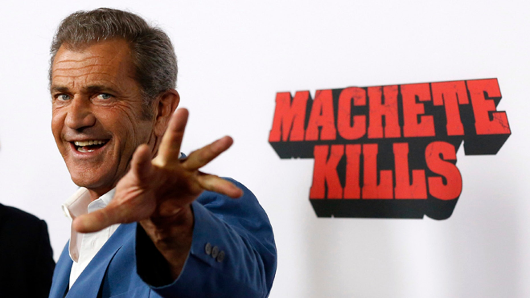"Cast member Mel Gibson poses at the premiere of ""Machete Kills"" in Los Angeles, California October 2, 2013. The movie opens in the U.S. on October 11.   REUTERS/Mario Anzuoni  (UNITED STATES - Tags: ENTERTAINMENT PROFILE) - RTR3FJHD"