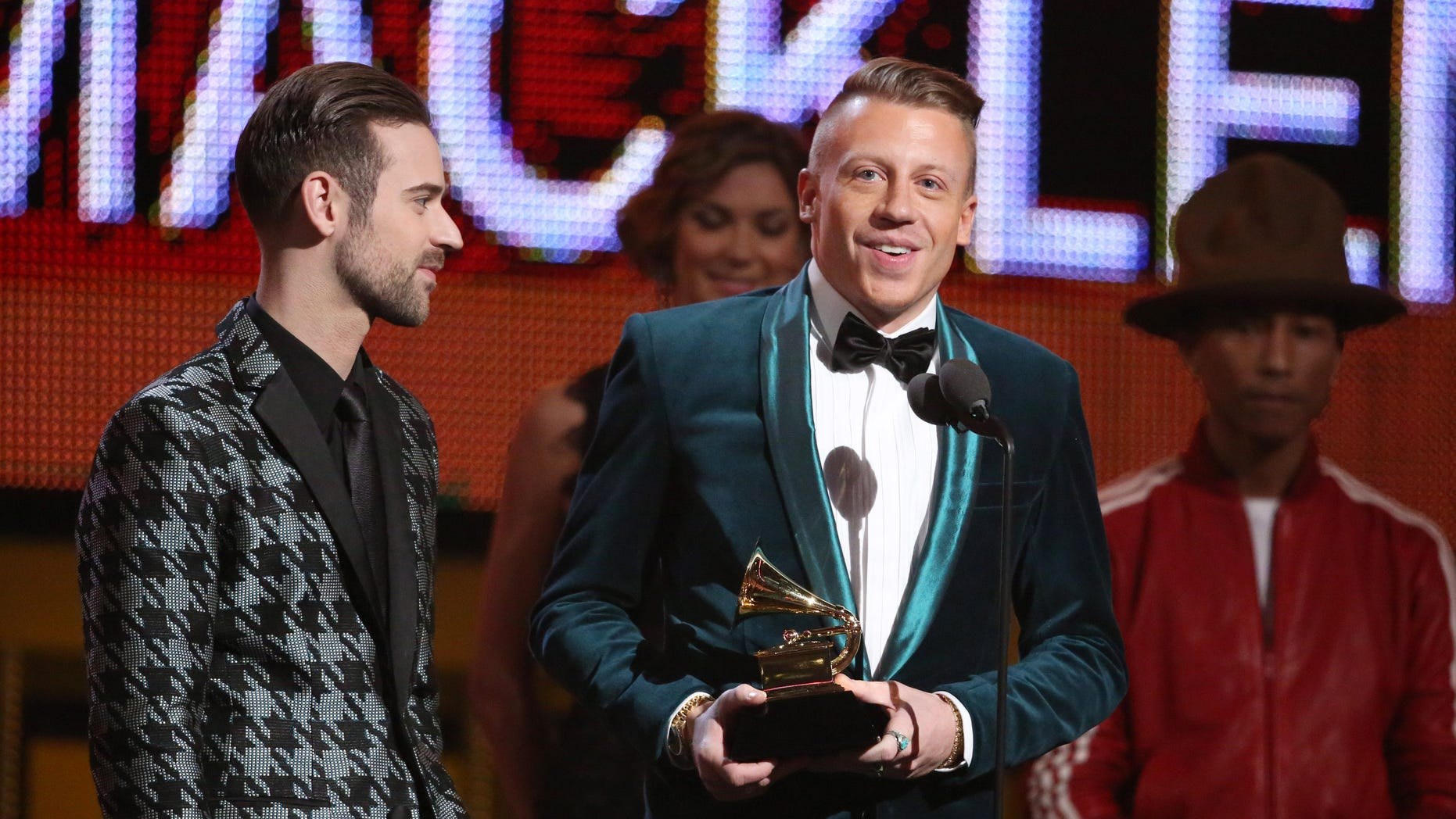Ryan Lewis, left, and Macklemore accept the award for best new artist at the 56th annual Grammy Awards at Staples Center on Sunday, Jan. 26, 2014, in Los Angeles. (Photo by Matt Sayles/Invision/AP)
