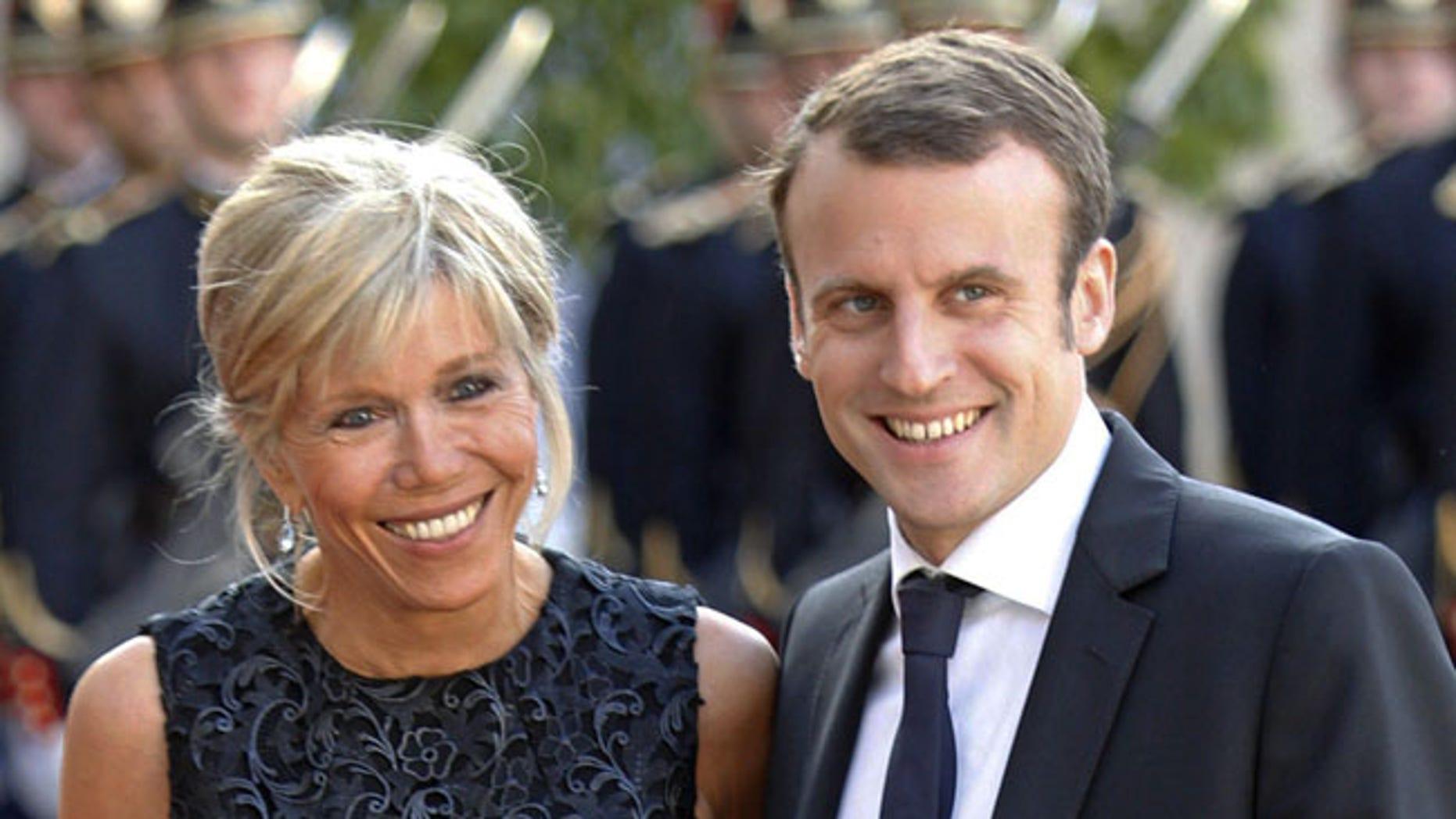 Emmanuel Macron is seen with his wife Brigitte Trognuex at the Elysee Palace in Paris, France, June 2, 2015.