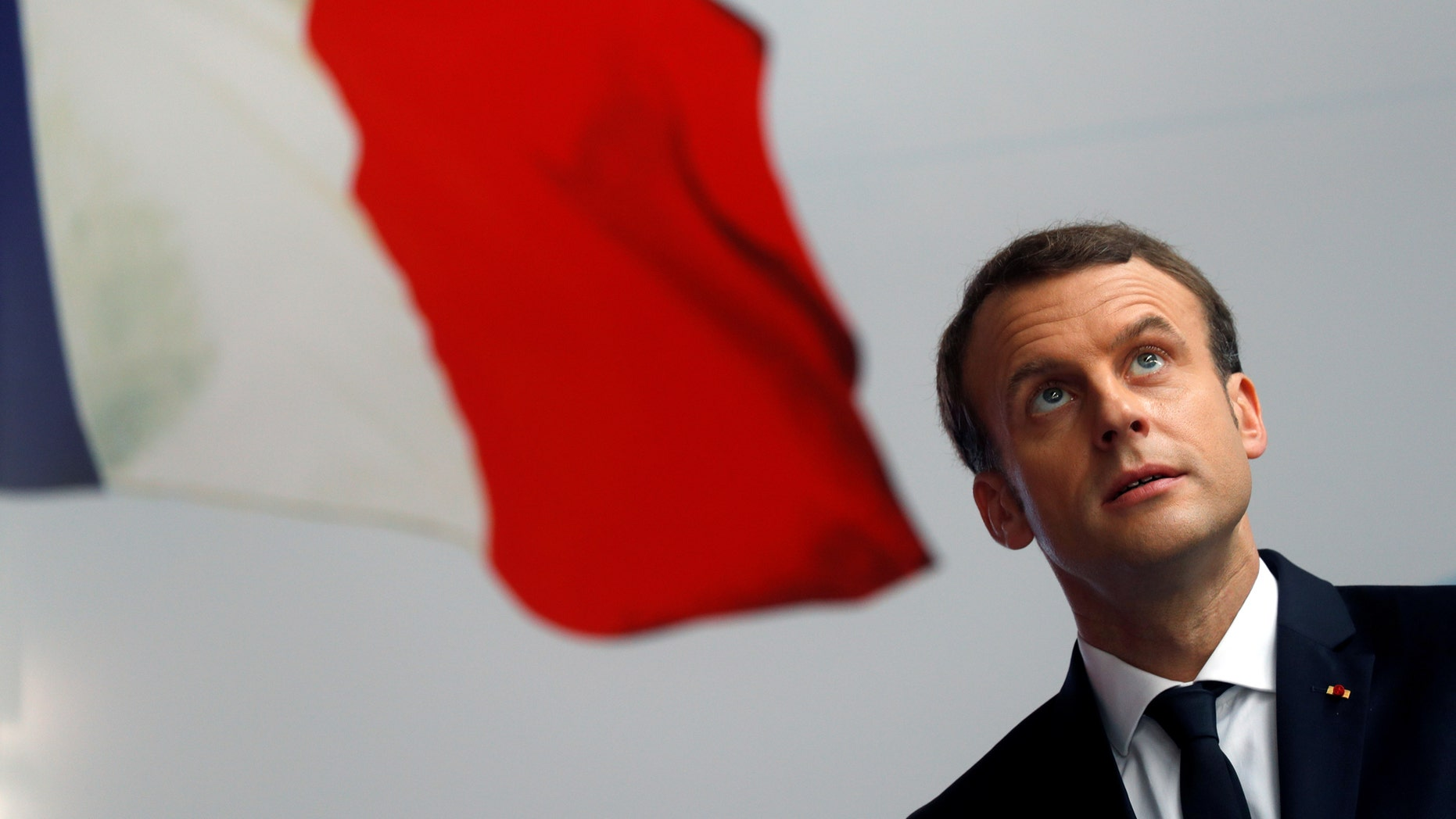 File photo - French President Emmanuel Macron attends a ceremony to start the construction of the first metro line in Abidjan, Ivory Coast, Nov. 30, 2017. (REUTERS/Philippe Wojazer) -