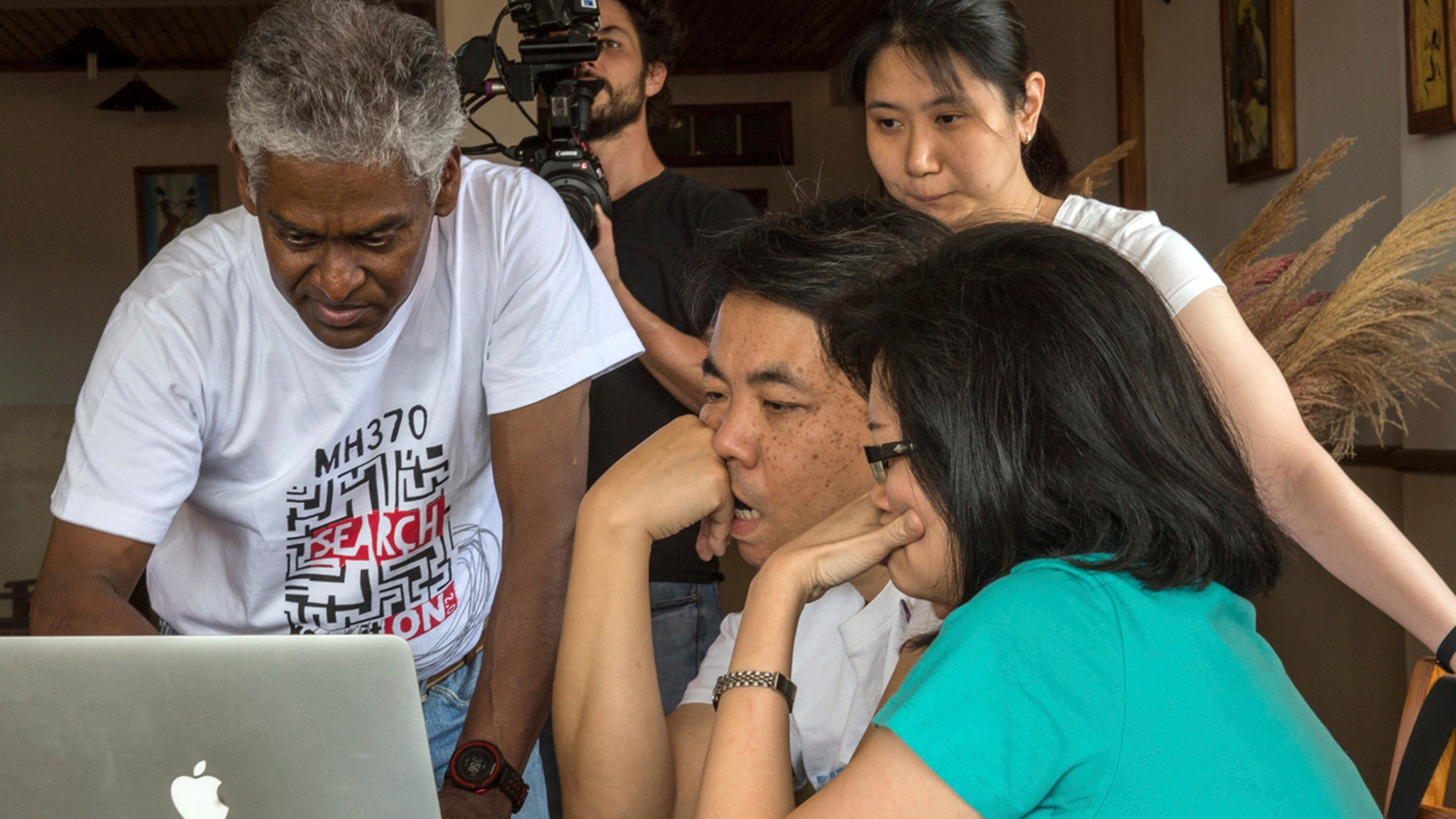 V.P.R. Nathan, left, whose wife, Anne Daisy, was on board the missing Malaysia plane, talks with other relatives of passengers during their meeting at a hotel in Antananarivo, Madagascar, Sunday, Dec.4, 2016.