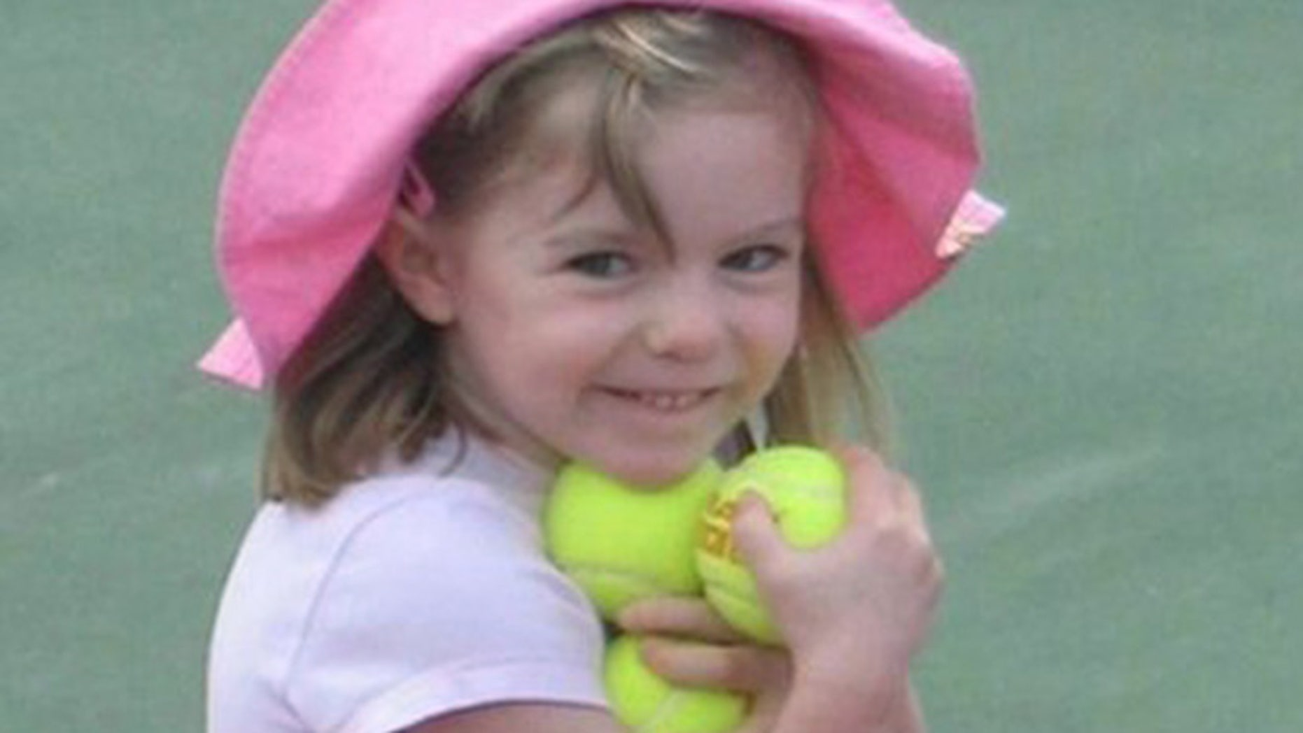 "This undated  file photo made available by the London Metropolitan Police shows missing British girl Madeleine McCann before she vanished from a Portuguese holiday complex on Thursday, May 3, 2007. The new book, ""Looking for Madeleine""focuses on the investigation into the girl's disappearance."