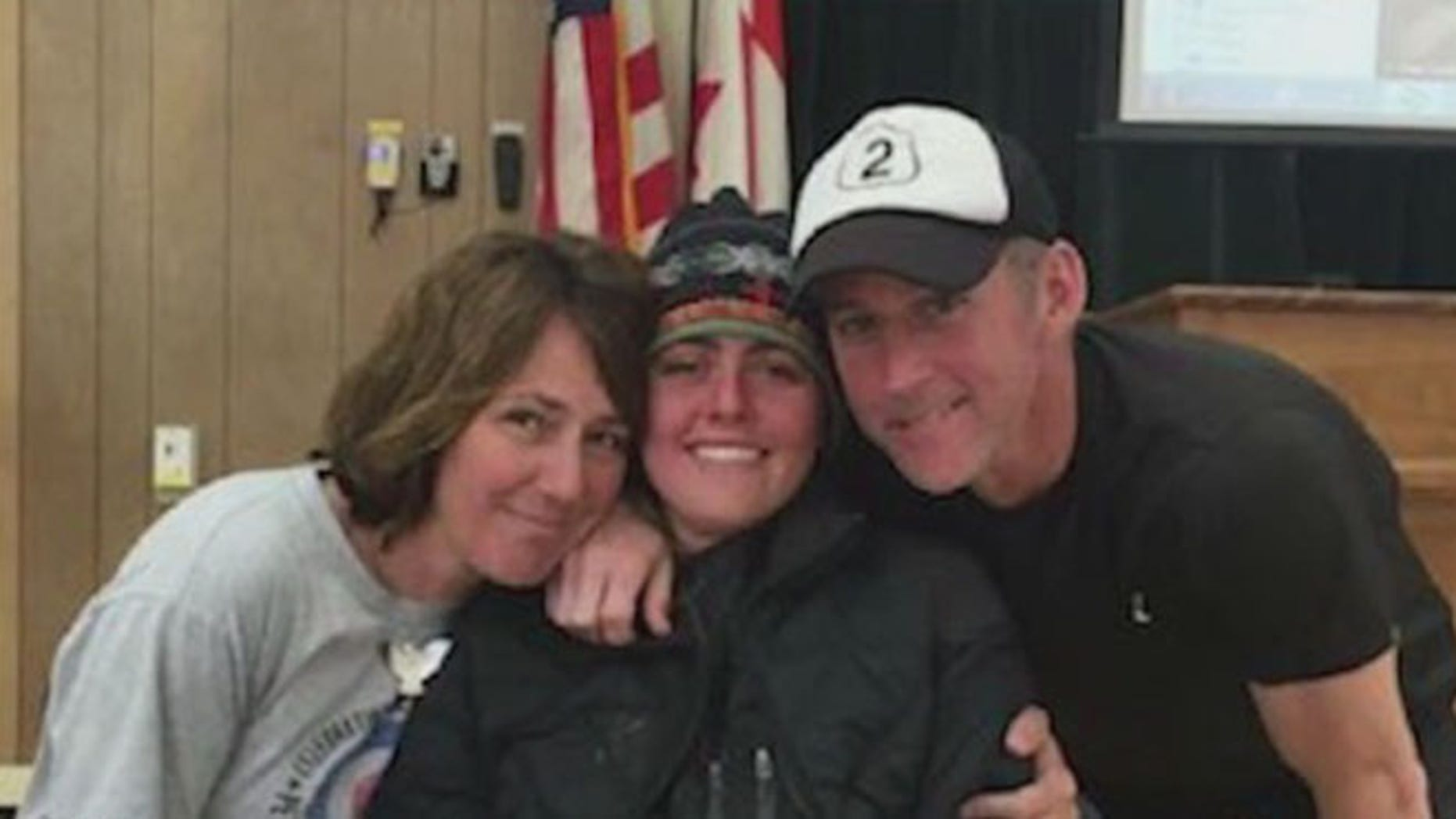 Missing hiker Madeline Connelly 23, got hugs from her parents at Glacier Park Headquarters after being found.