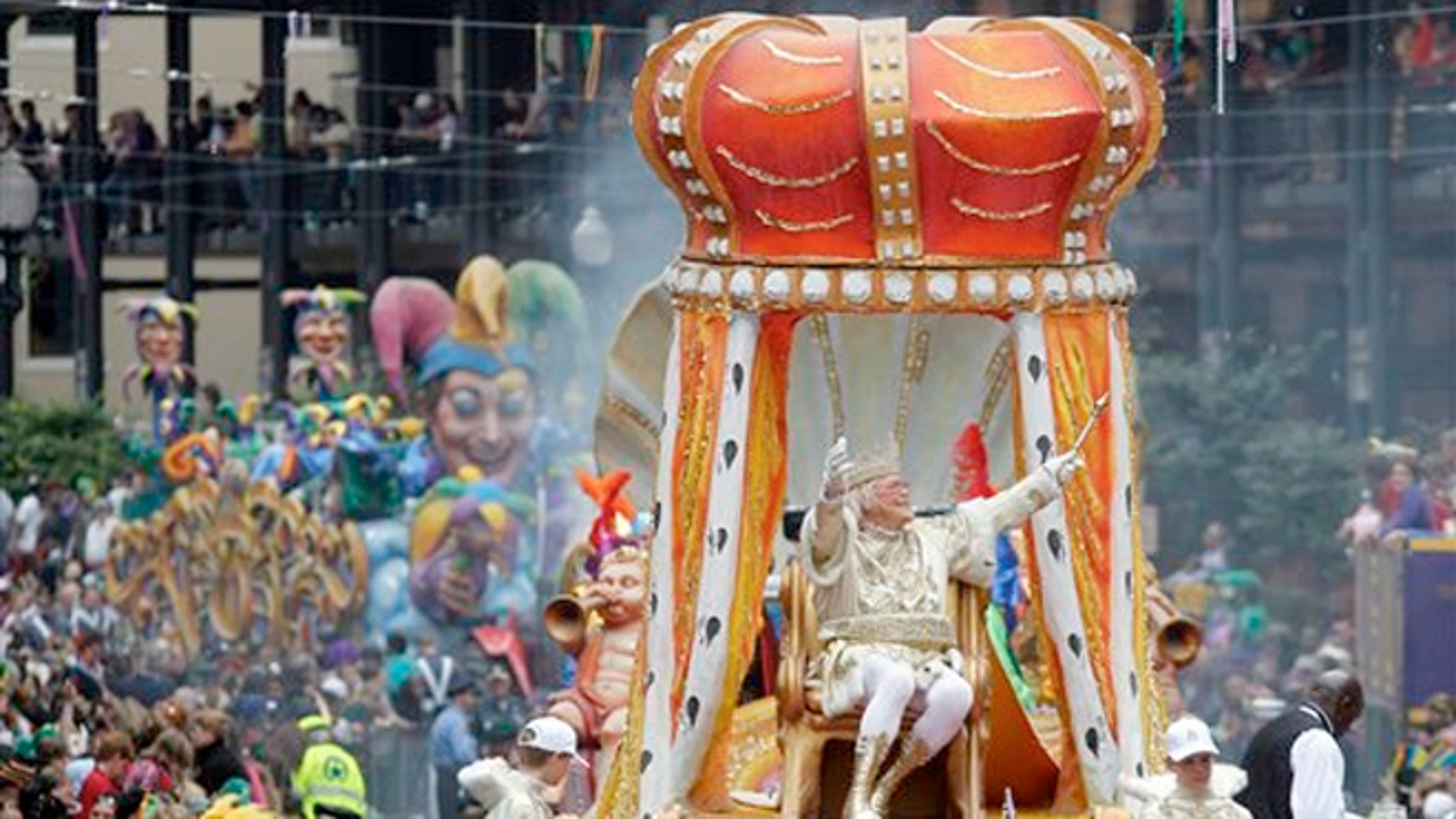 FILE : Rex, the King of Carnival rides in the Krewe of Rex as he arrives at Canal St. on Mardi Gras day in New Orleans.