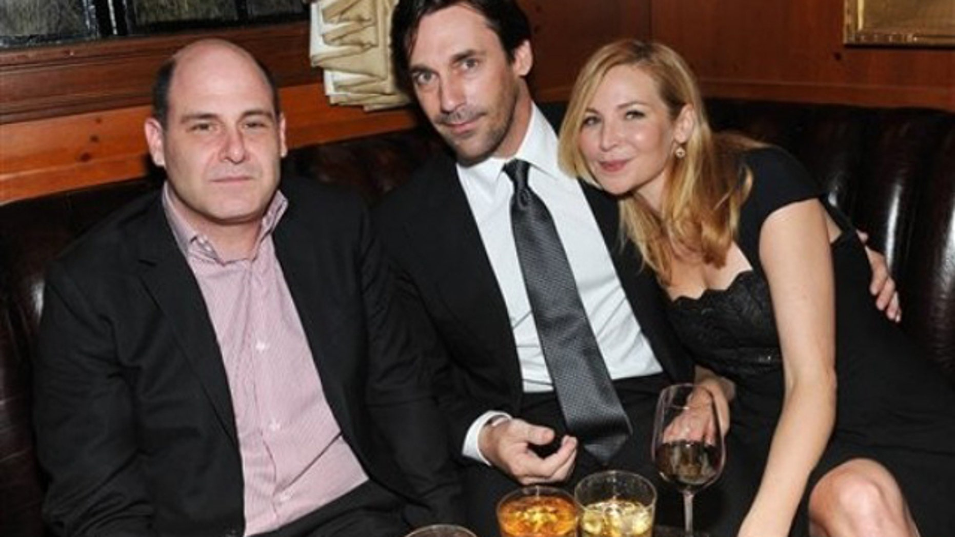 Series creator and executive producer Matthew Weiner, left, and actor Jon Hamm and actress Jennifer Westfeldt attend the 'Mad Men' Season 4 Finale screening at the 21 Club in New York City