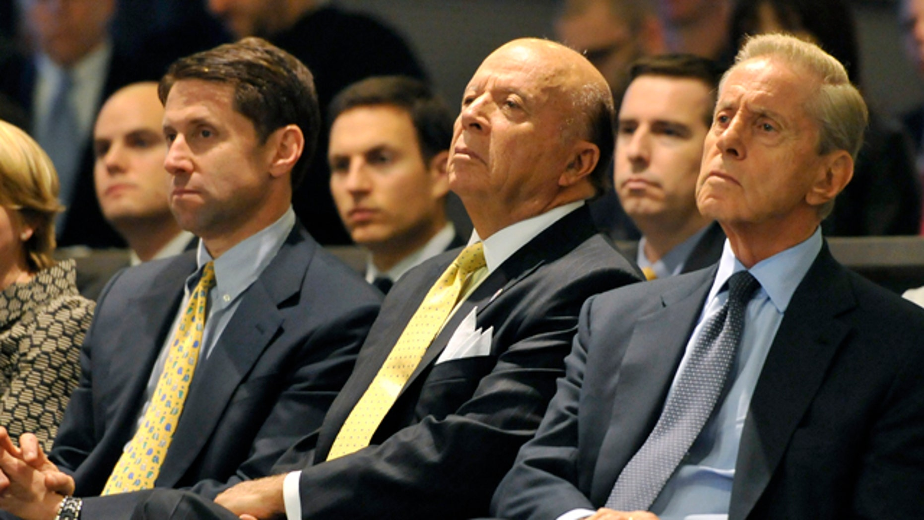 Oct. 29, 2010: FILE - This photo shows New York Mets owners from left, Jeff Wilpon, Saul Katz and Fred Wilpon during a baseball news conference in New York. The Mets owners and a trustee for Bernard Madoff's fraud victims have settled for $162 million.