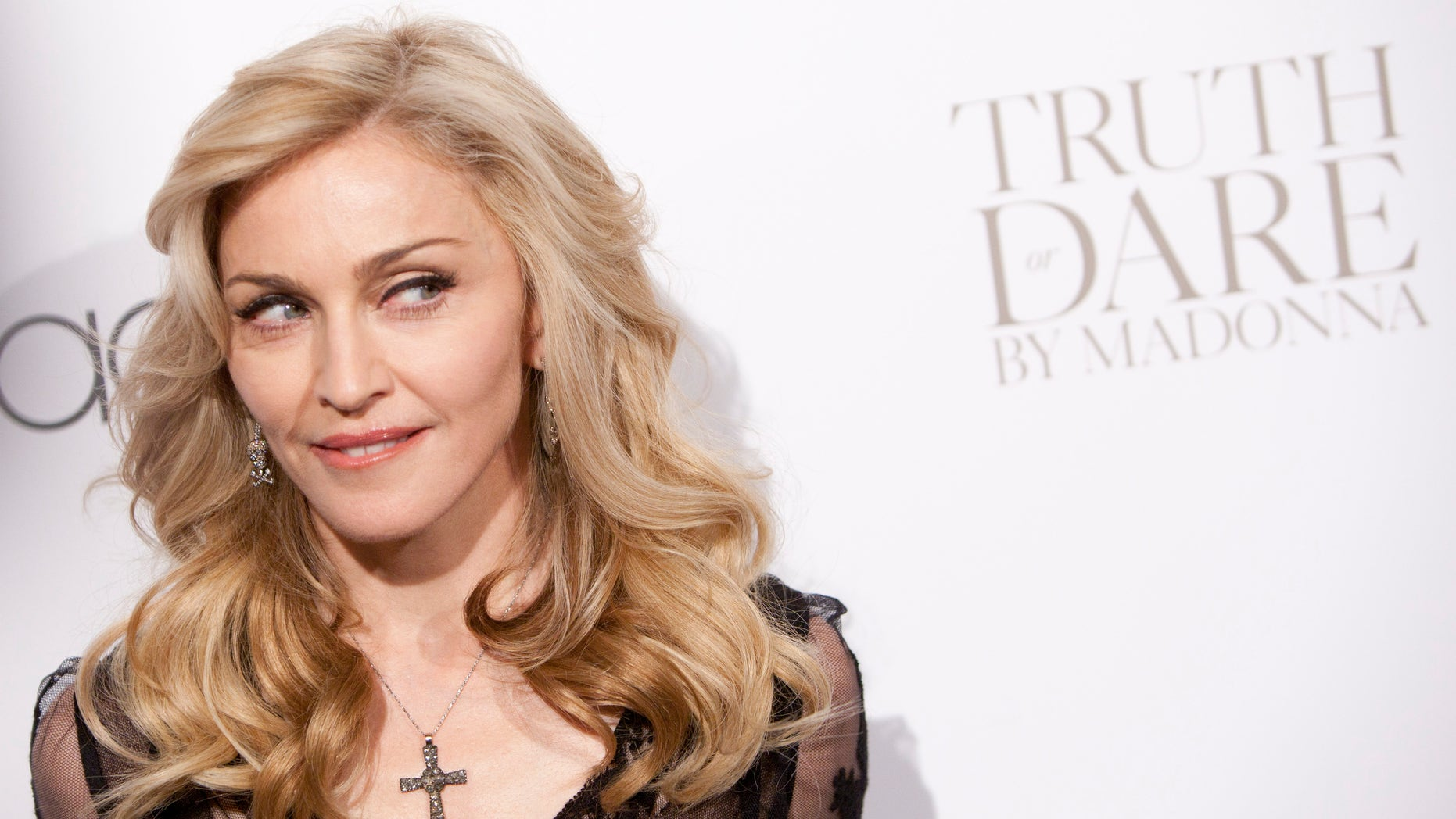 """April 12, 2012. Madonna arrives to the launch of her new fragrance, """"Truth or Dare"""" by Madonna at Macy's in New York."""