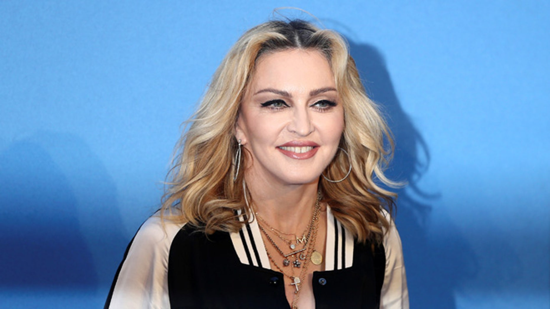 Madonna visited homeless LGBT youth on Thanksgiving.