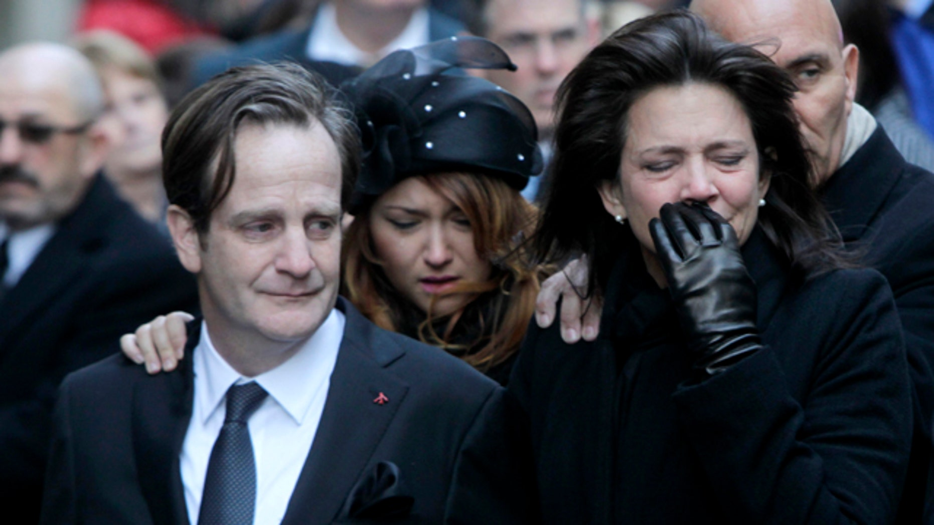 Jan. 5, 2012: Matthew Badger, left, and Madonna Badger, the parents of three children that were killed in a fire, react as their caskets are carried into a church during the funeral in New York.