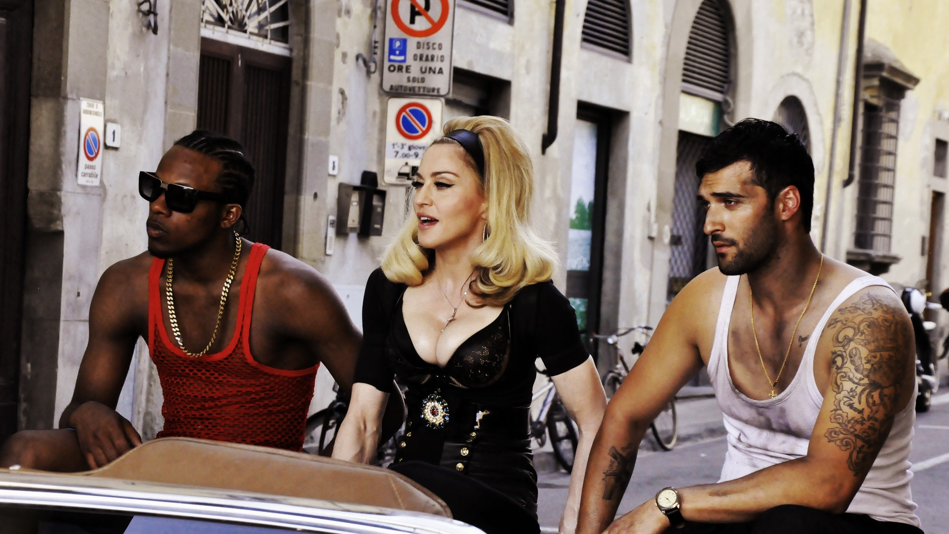 This undated image released by Guy Oseary shows pop star Madonna, center, during the filming of her music video for her new single, Turn Up The Radio, in Florence, Italy.