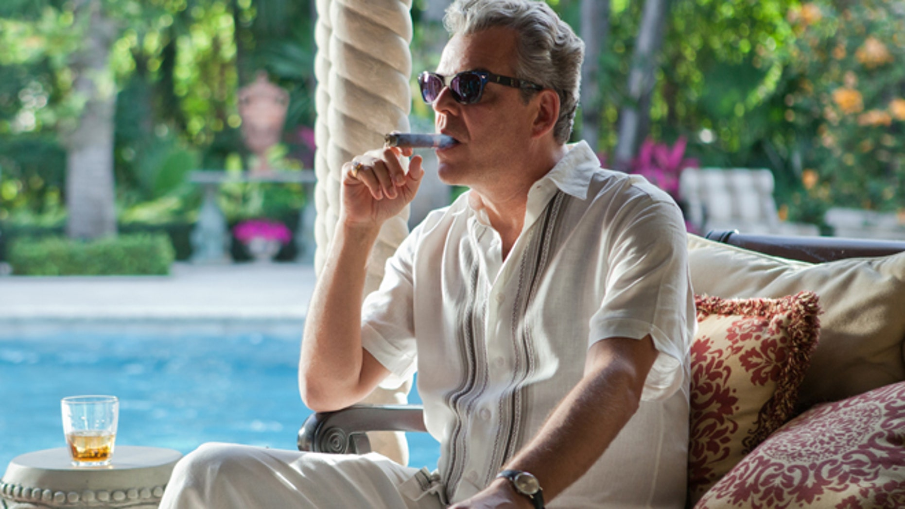 """This publicity image released by Starz, shows Danny Huston in a scene from the second season of the series """"Magic City,"""" set in Miami, Fla."""