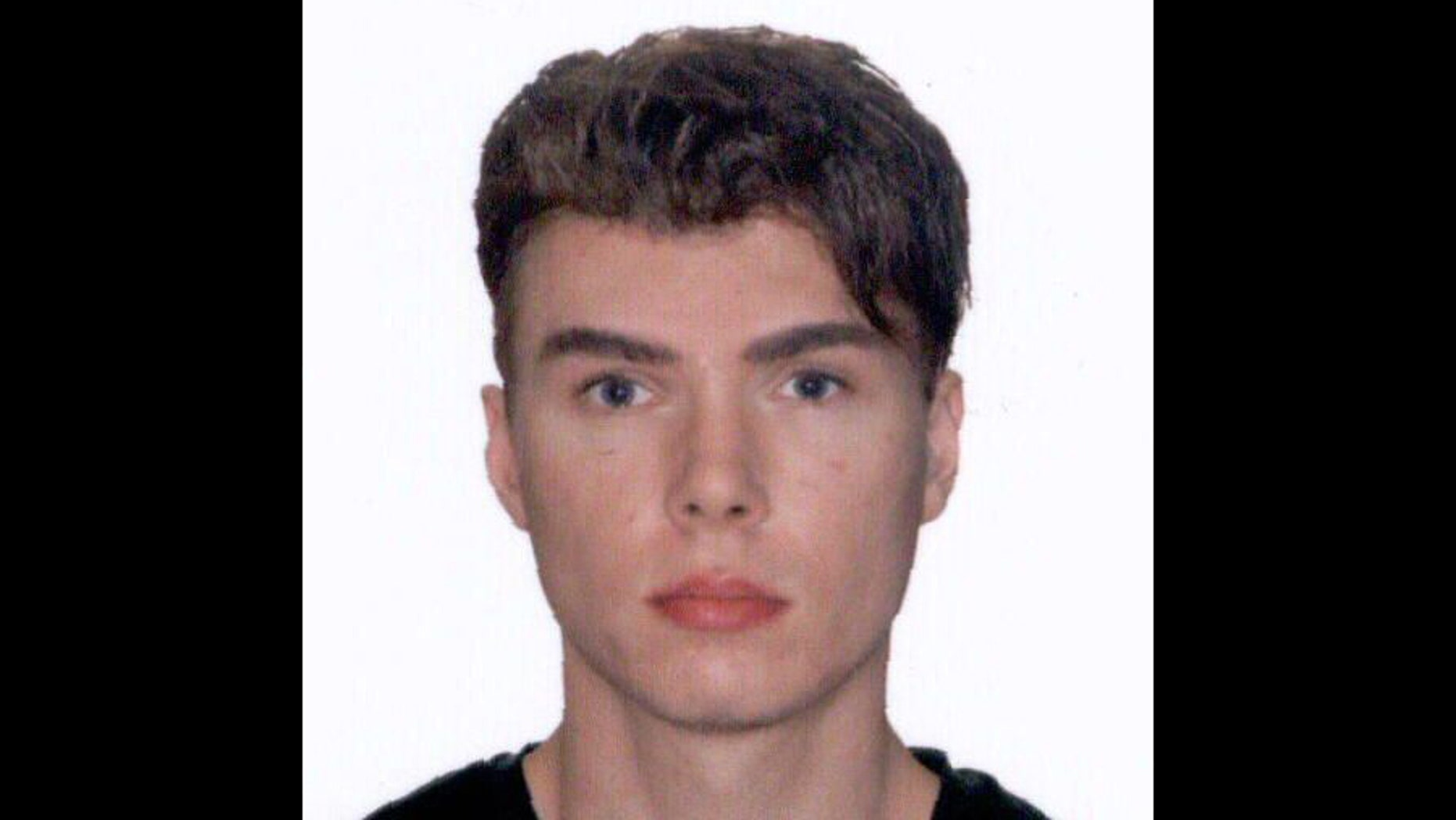 This image provided by Interpol shows an undated photo of Luka Rocco Magnotta, 29 years-old, who is accused of videotaping a gruesome murder before posting it to the internet will be charged with threatening Canada's prime minister after mailing a severed foot to his Conservative party headquarters, police said.
