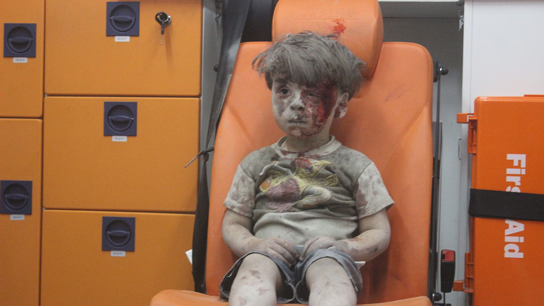Omran Daqneesh sits in an ambulance after being pulled out of a building hit by an airstrike in Aleppo, Syria on Aug. 17, 2016.