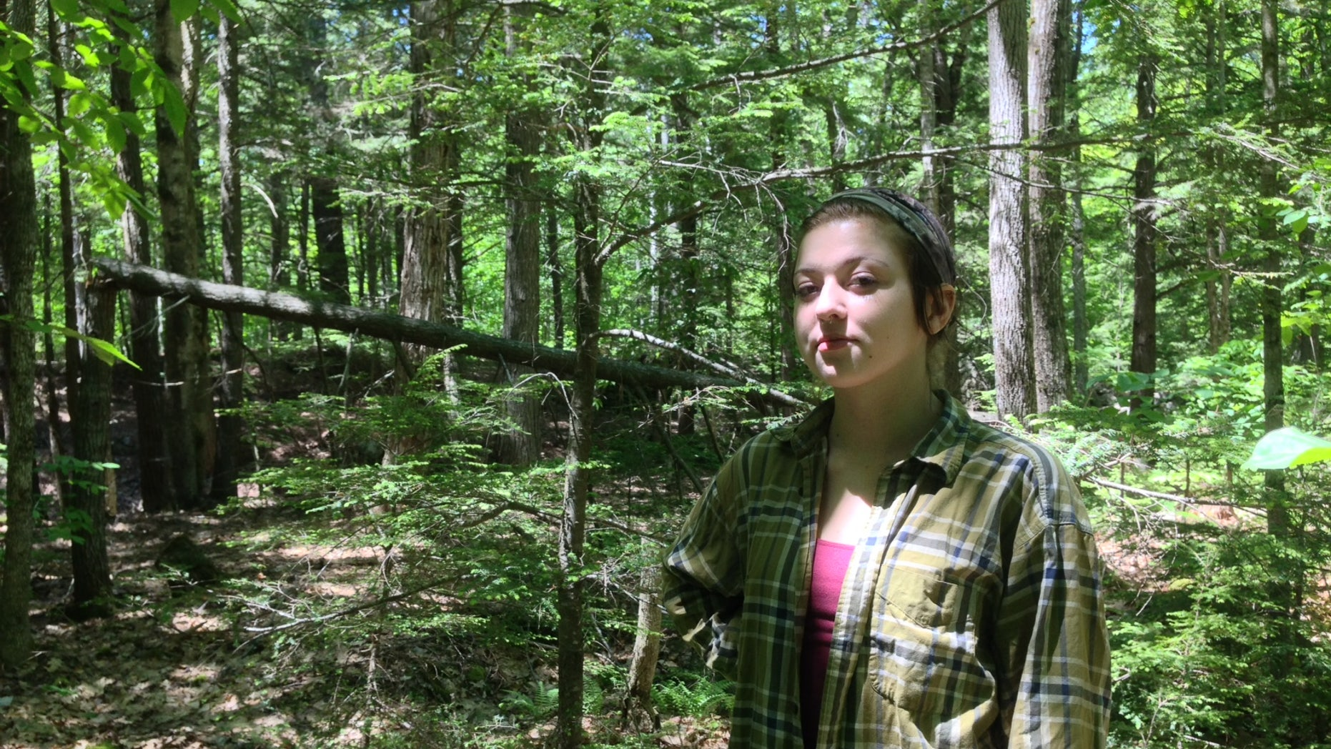 Rachel Borch, 21, stands in the woods near her home in Hope. Borch was attacked while on a jog in woods near her home by a rabid raccoon and had to drown the animal in self defense. (Alex Acquisto, Bangor Daily News)