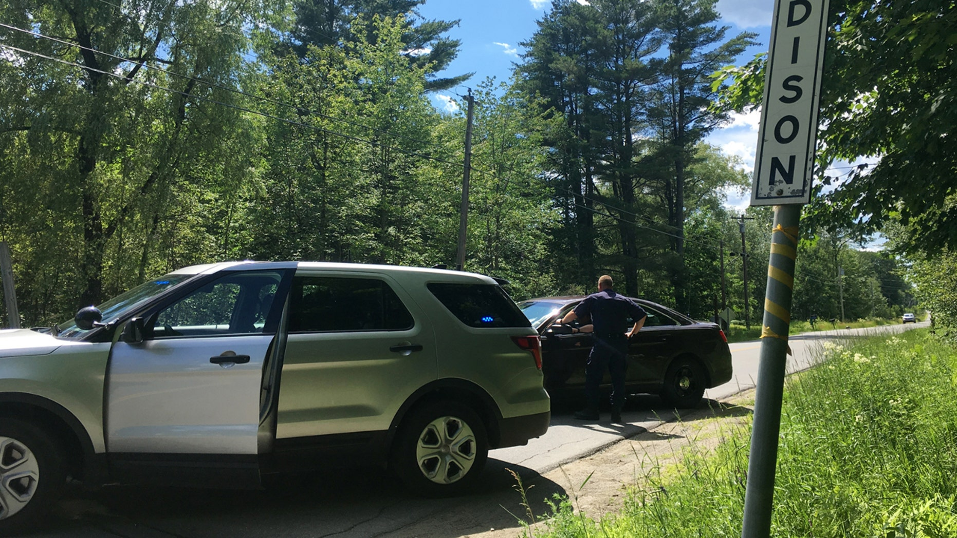 State police in Madison, Maine, have closed the country road Wednesday, July 5, 2017, where a series of Wednesday shootings left three victims dead and one injured.