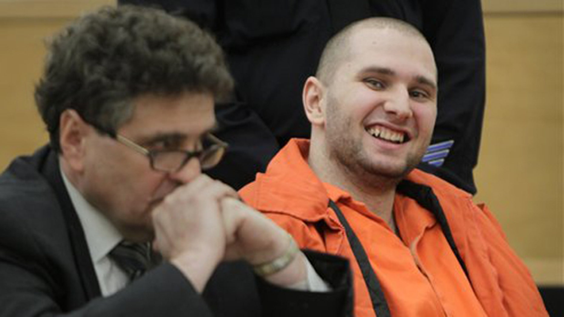 Jan. 18, 2012: Maksim Gelman, right, laughs during his sentencing at Supreme Court in New York.