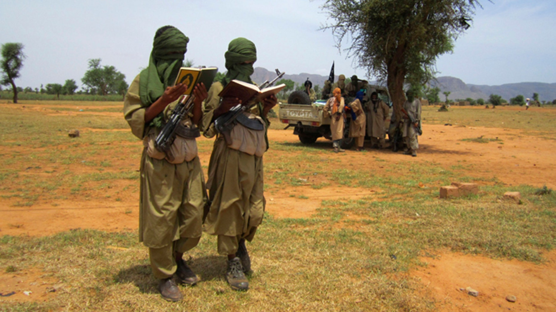 Sept. 27, 2012: Two young fighters read out Quranic verses for a journalist, at the request of their Islamist commanders, in Douentza, Mali.