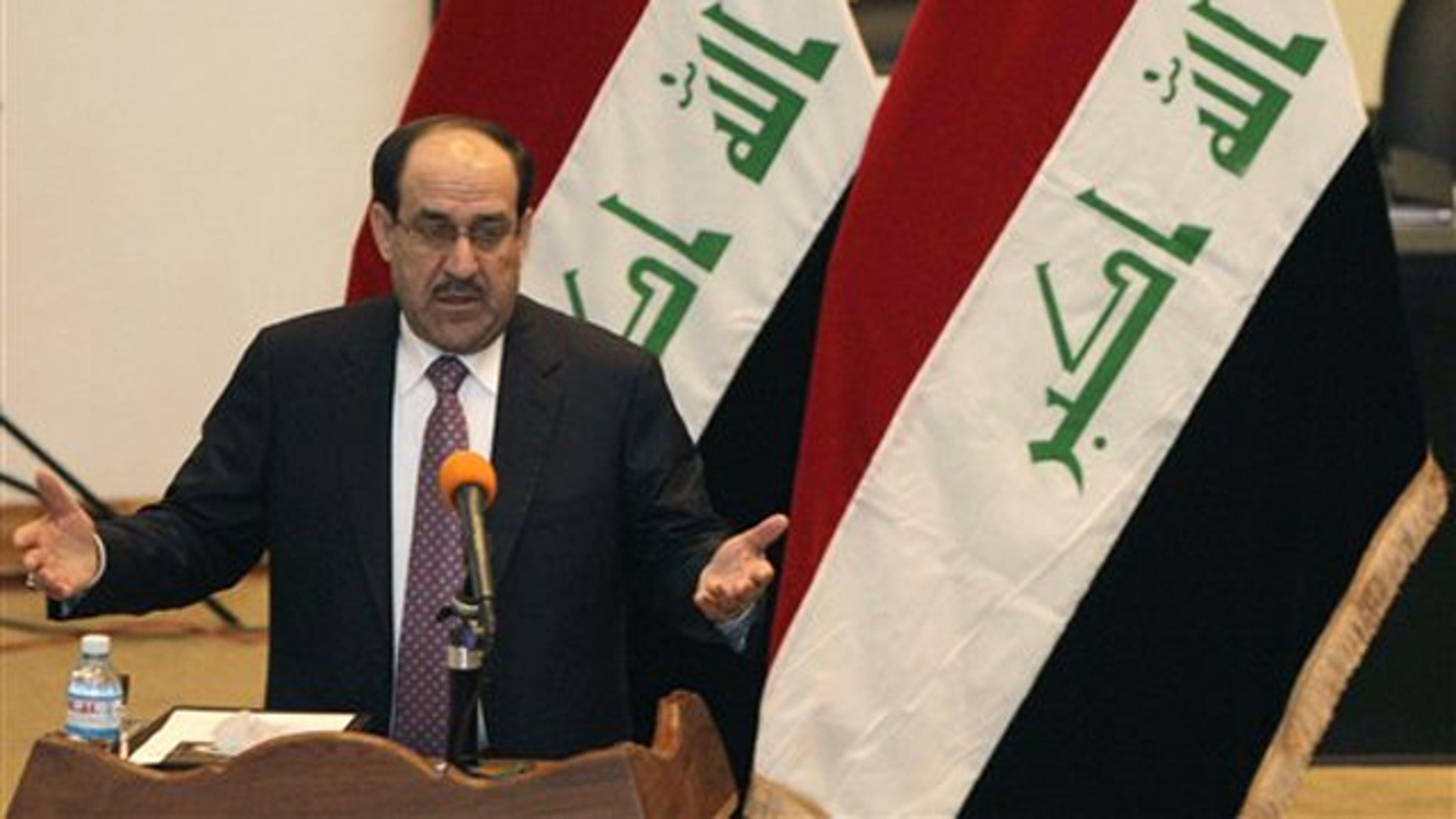 Iraqi Prime Minister Nouri al-Maliki speaks to Iraqi lawmakers before submitting his new government for approval in Baghdad, Iraq, Dec. 21.