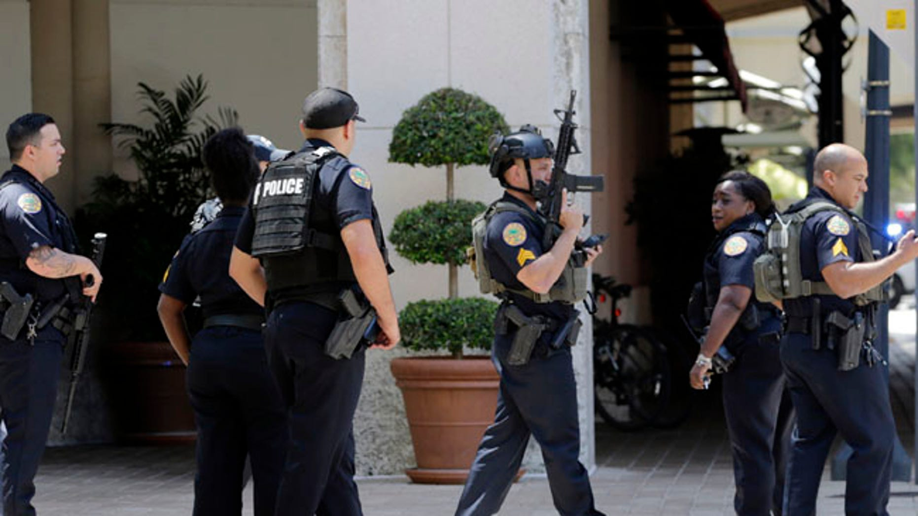 Police patrol outside of the Shops at Merrick Park after a shooting Saturday in Coral Gables, Florida.