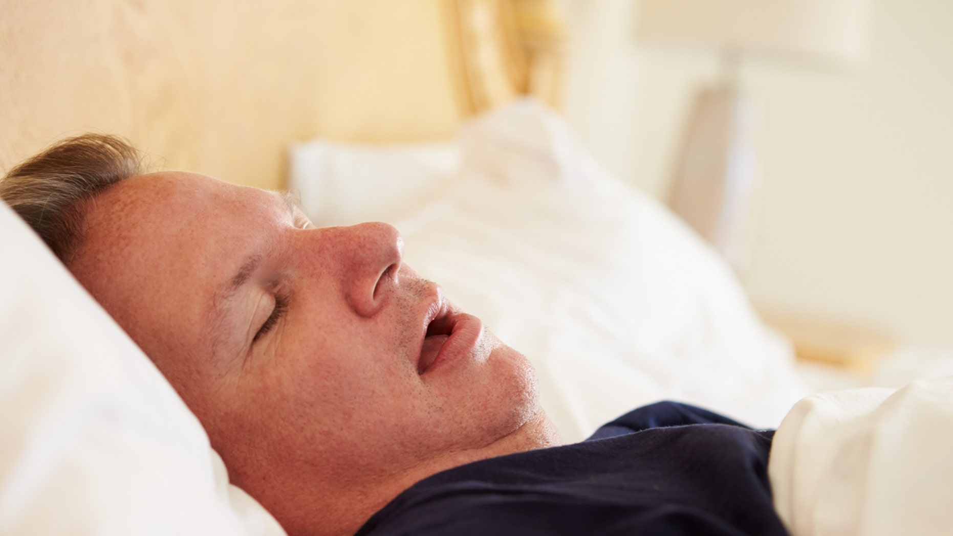 Overweight Man Asleep In Bed Snoring At Home On His Own