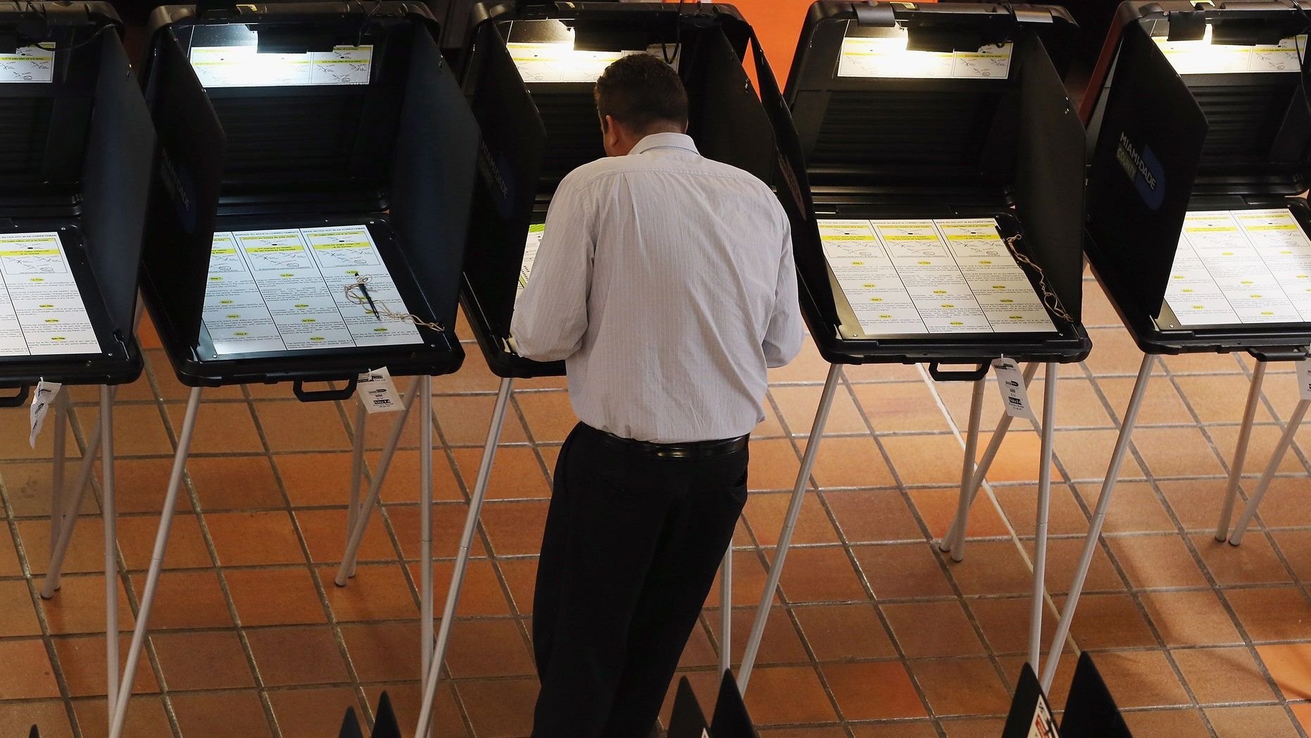 MIAMI, FL - APRIL 29:  A voter fills out a ballot during the early voting period on a ballot issue to decide if the Miami Dolphins and their owner Stephen Ross will be able to tap into $289 million in public funding that the team is seeking to help renovate their stadium on April 29, 2013 in Miami, Florida. Early voting started without a clear understanding if it will even be counted because the stadium renovation plan is dependent on the Florida legislature voting to increase the Miami-Dade mainland hotel tax rate from 6 to 7 percent and they have not yet decided to  vote on that issue themselves.  (Photo by Joe Raedle/Getty Images)