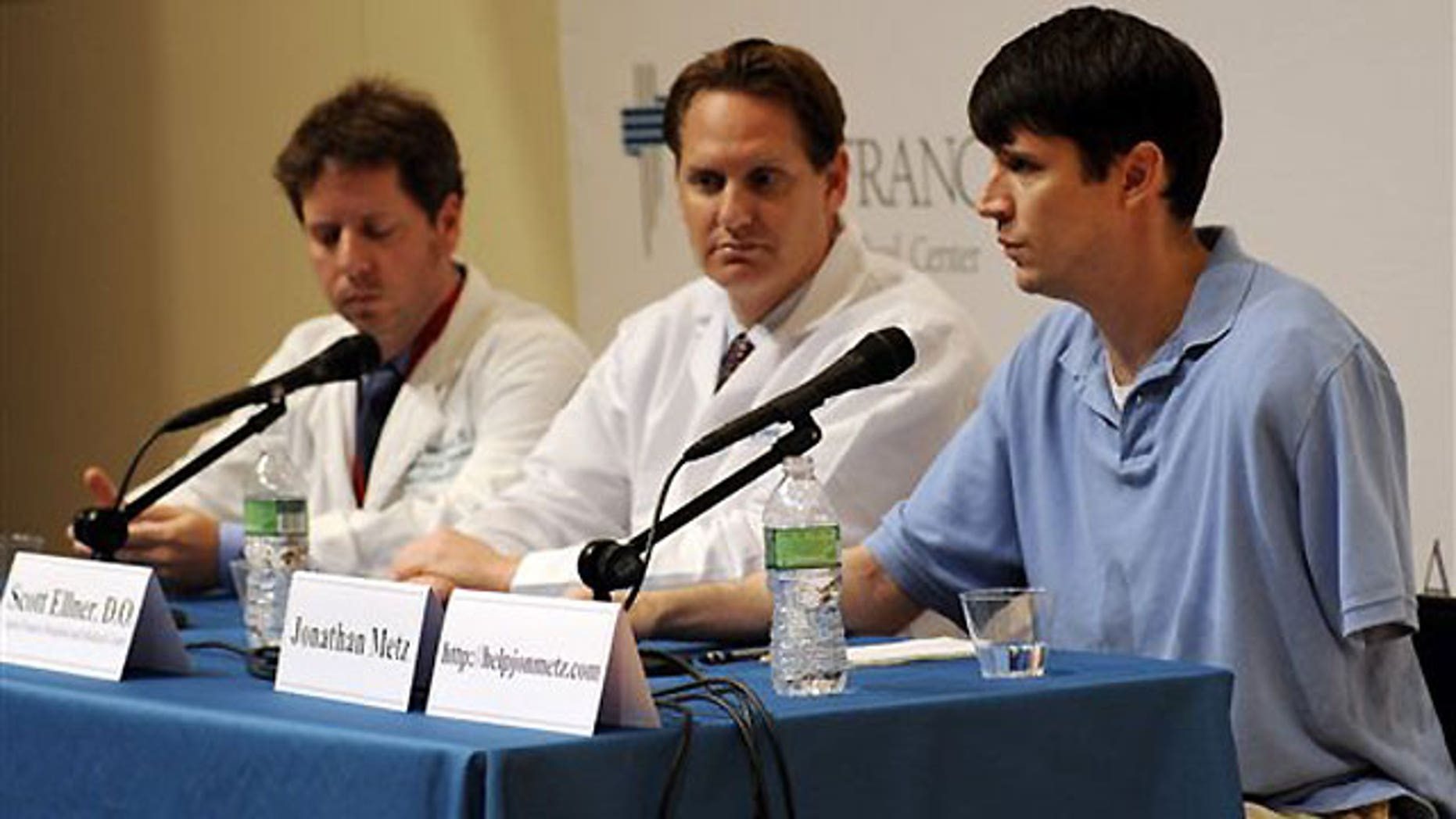 June 15: Jonathan Metz speaks at a news conference at St. Francis Hospital in Hartford, Conn. Metz had his arm stuck in his furnace boiler for about 12 hours when he concluded that amputating the limb was his only chance for survival.