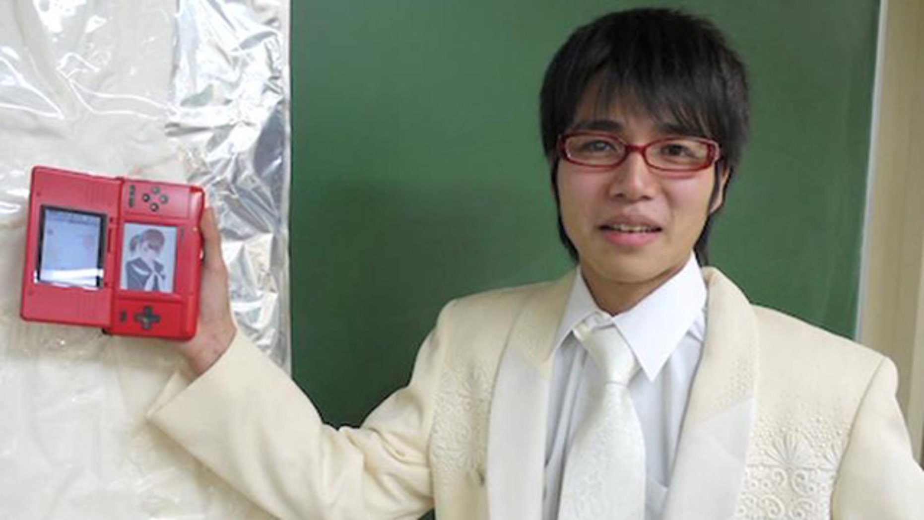 In this screen from a YouTube video of the wedding ceremony, gamer Sal9000 shows off the love of his life -- Nene Anegasaki, the star of dating simulation game Love Plus.