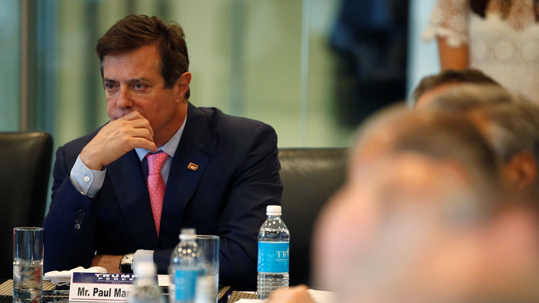 Paul Manafort of Republican presidential nominee Donald Trump's staff listens during a round table discussion on security at Trump Tower in the Manhattan borough of New York, U.S., August 17, 2016. REUTERS/Carlo Allegri - RTX2LL4K