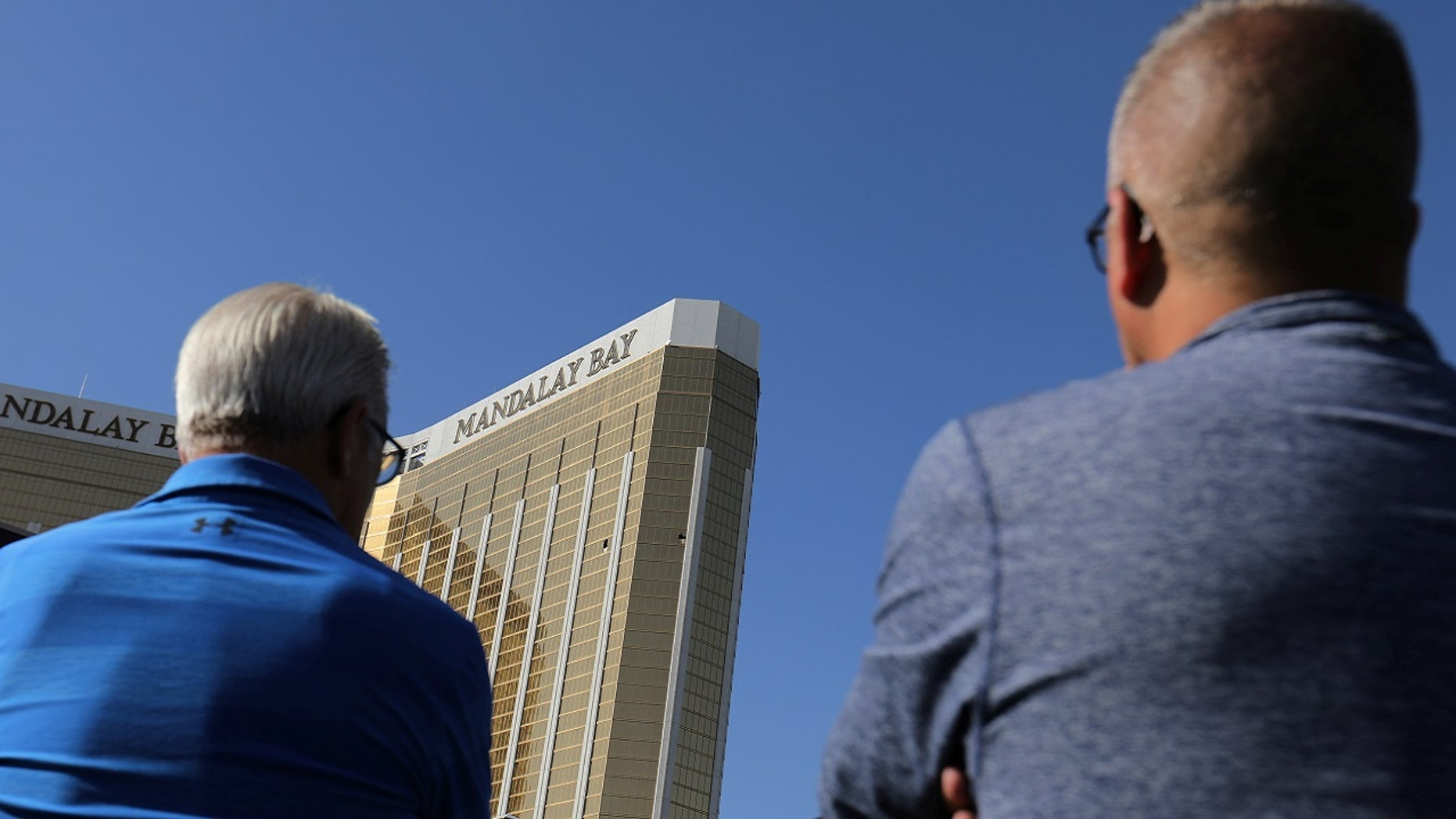 Tourists look up at the broken windows on the Mandalay Bay hotel where shooter Stephen Paddock conducted his mass shooting along the Las Vegas Strip in Las Vegas, Nev., October 4, 2017. The hotel will be renumbering its floors, a report said Thursday.
