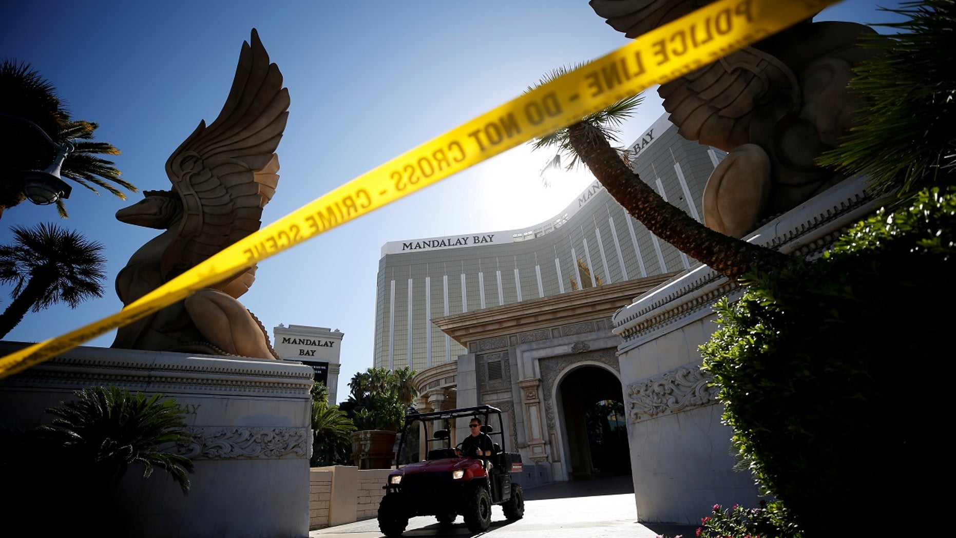 A member of the FBI leaves the Mandalay Bay hotel following the mass shooting in Las Vegas, Oct. 4, 2017.