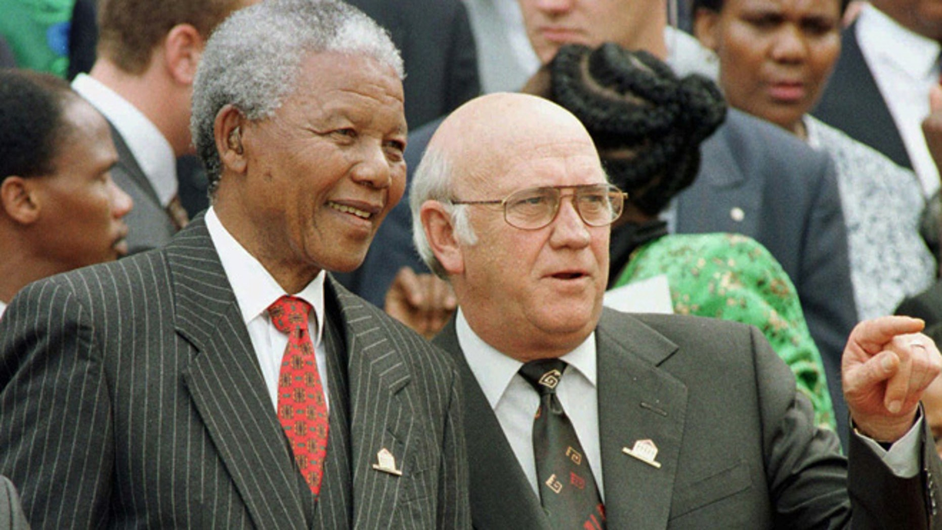 In this Wednesday May 8, 1996 file photo, South African President Nelson Mandela, left, and Deputy President F.W. de Klerk chat outside Parliament after the approval of South Africa's new constitution. de Klerk, the last leader of the apartheid era and a co-recipient of the 1993 Nobel Peace Prize with Nelson Mandela, has suffered dizziness and will be fitted with a pacemaker, Tuesday June 2, 2013, to help his heart function.