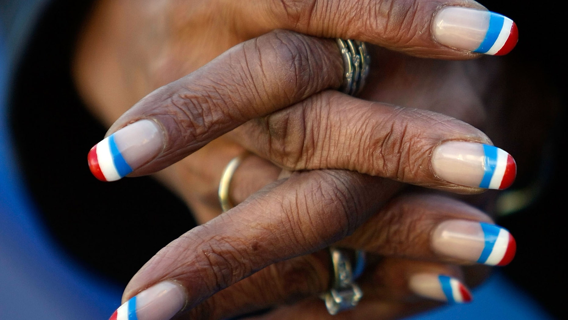 RALEIGH, NC - OCTOBER 29:  A women with finger nails painted red, white and blue listens to U.S. Sen. Barack Obama (D-IL) speak at a campaign rally at Hallifax Mall October 29, 2008 in Raleigh, North Carolina. With less than a week to go before election day, Sen. Obama continues to campaign in battleground states.  (Photo by Joe Raedle/Getty Images)