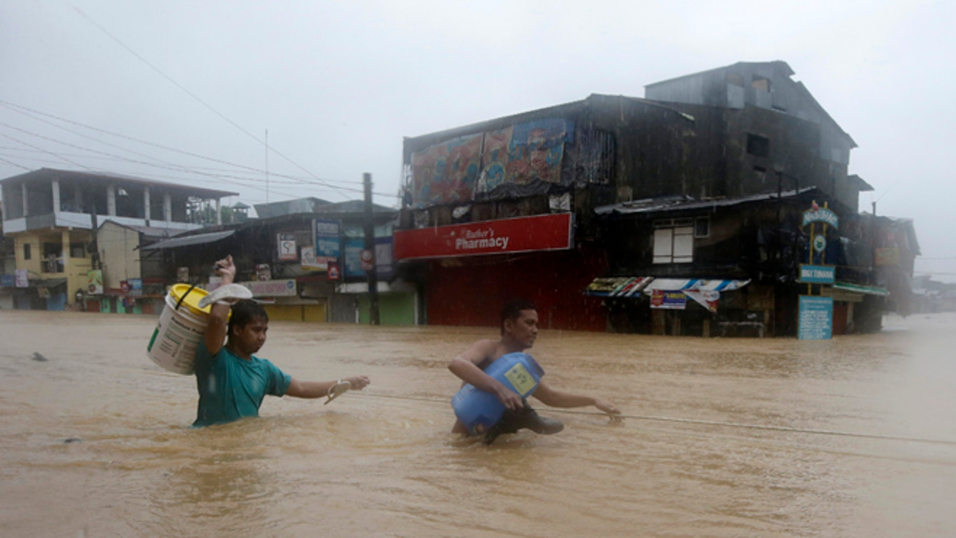Sept. 19, 2014: Residents make their way through deep floodwaters after heavy monsoon rains spawned by Tropical Storm Fung-Wong flooded Marikina city, east of Manila, Philippines.