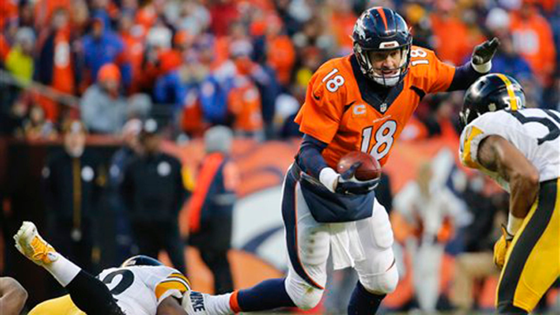 Denver Broncos quarterback Peyton Manning is sacked by Pittsburgh Steelers outside linebacker James Harrison, left, during the second half in an NFL football divisional playoff game, Sunday, Jan. 17, 2016, in Denver. (AP Photo/Jack Dempsey)