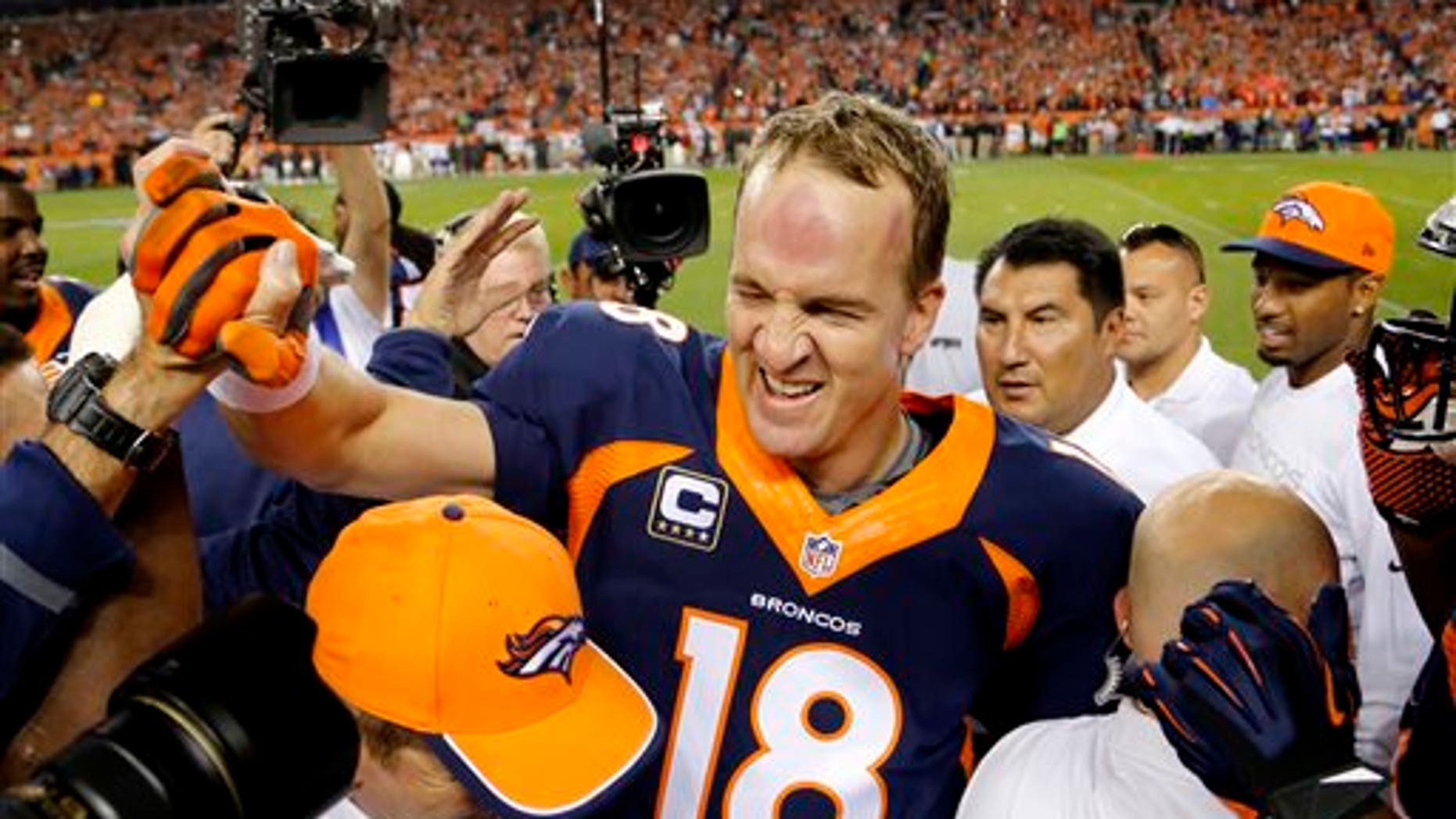 Oct. 19, 2014: Denver Broncos quarterback Peyton Manning (18) celebrates his 509th career touchdown pass with teammates during the first half of an NFL football game against the San Francisco 49ers.