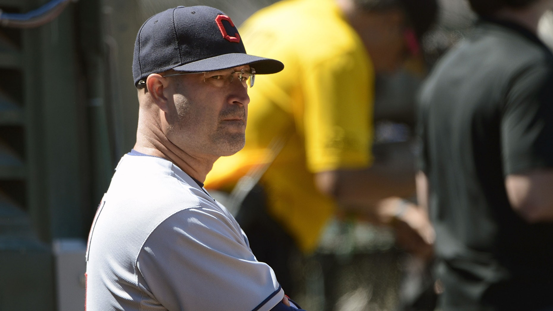 OAKLAND, CA - AUGUST 19:  Manager Manny Acta #11 of the Cleveland Indians looks on from the dugout in the six inning against the Oakland Athletics at O.co Coliseum on August 19, 2012 in Oakland, California.  (Photo by Thearon W. Henderson/Getty Images)