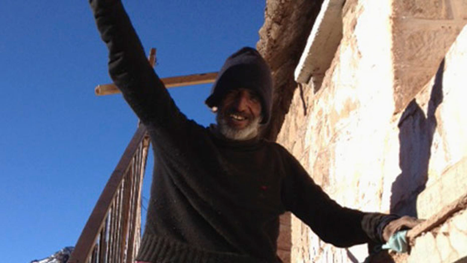 Sept, 8, 2013: Uruguayan man Raul Fernando Gomez Circunegui, 58, poses outside the shelter where he was found after disappearing four months ago in the remote Andes Mountains of San Juan Province.