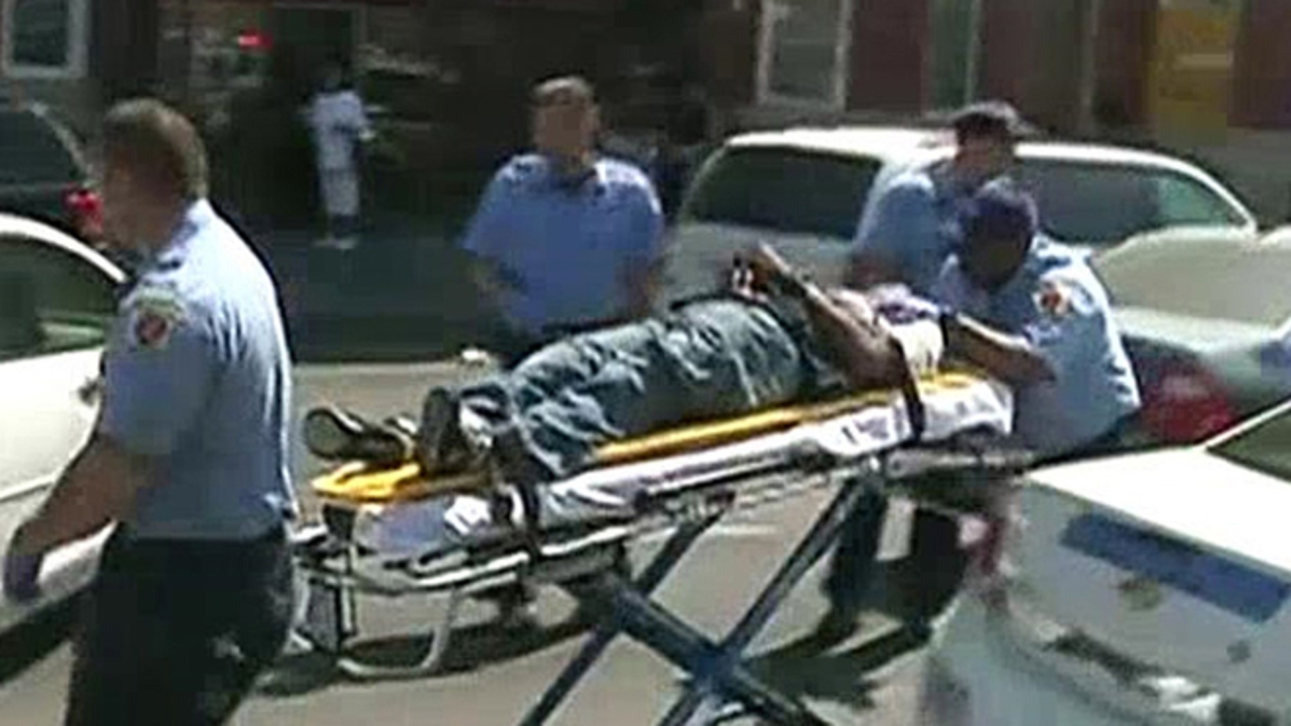 The unidentified man is seen in a stretcher after gunfire was heard Monday in Baltimore, Md.