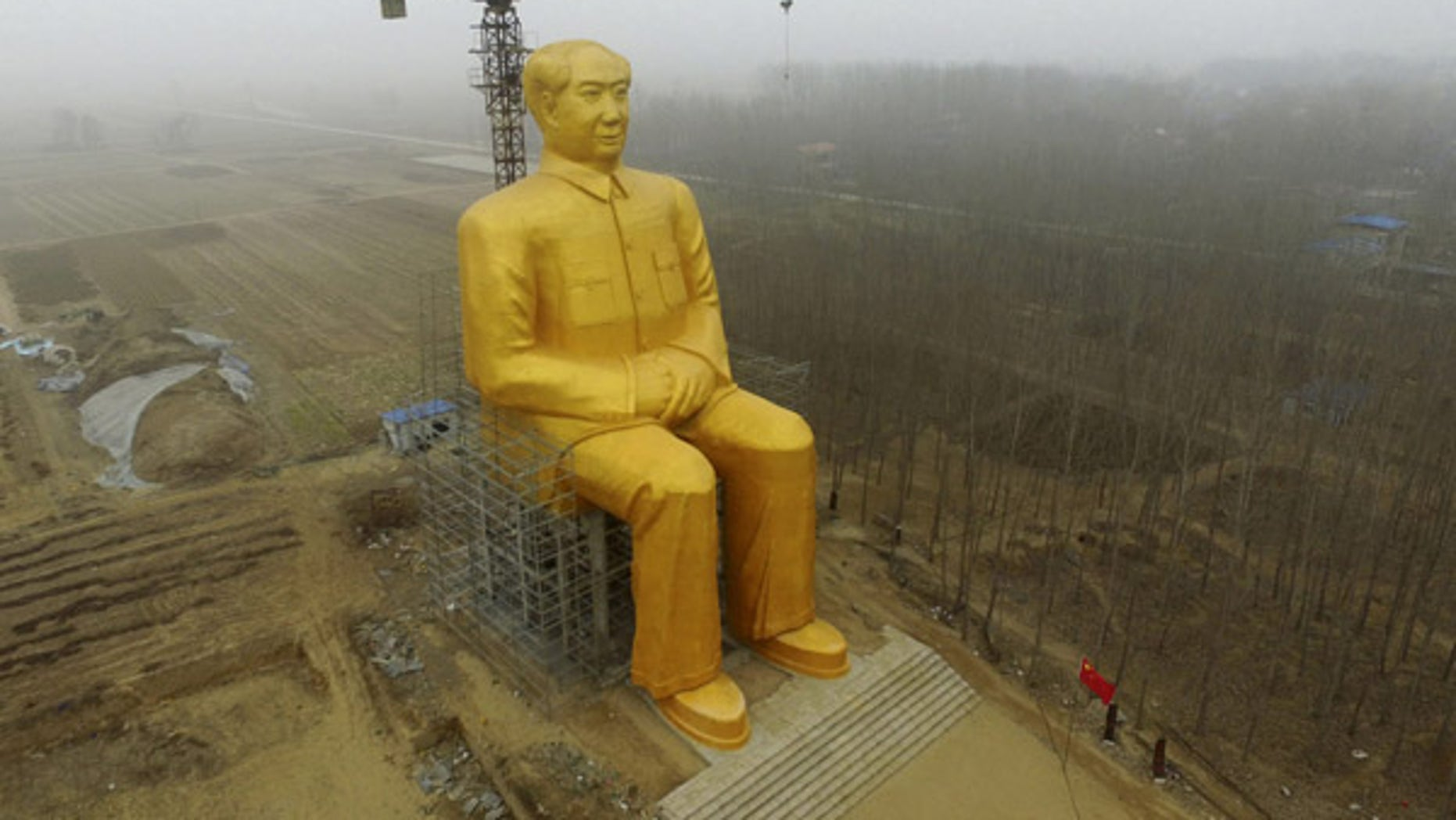 Jan. 4, 2016: A 120-foot tall gold-colored statue of former Chinese leader Mao Zedong is surrounded by farmland in Tongxu County in central China's Henan province. According to Chinese state media, businessmen and local villagers contributed nearly $460,000 to build the cement statue.
