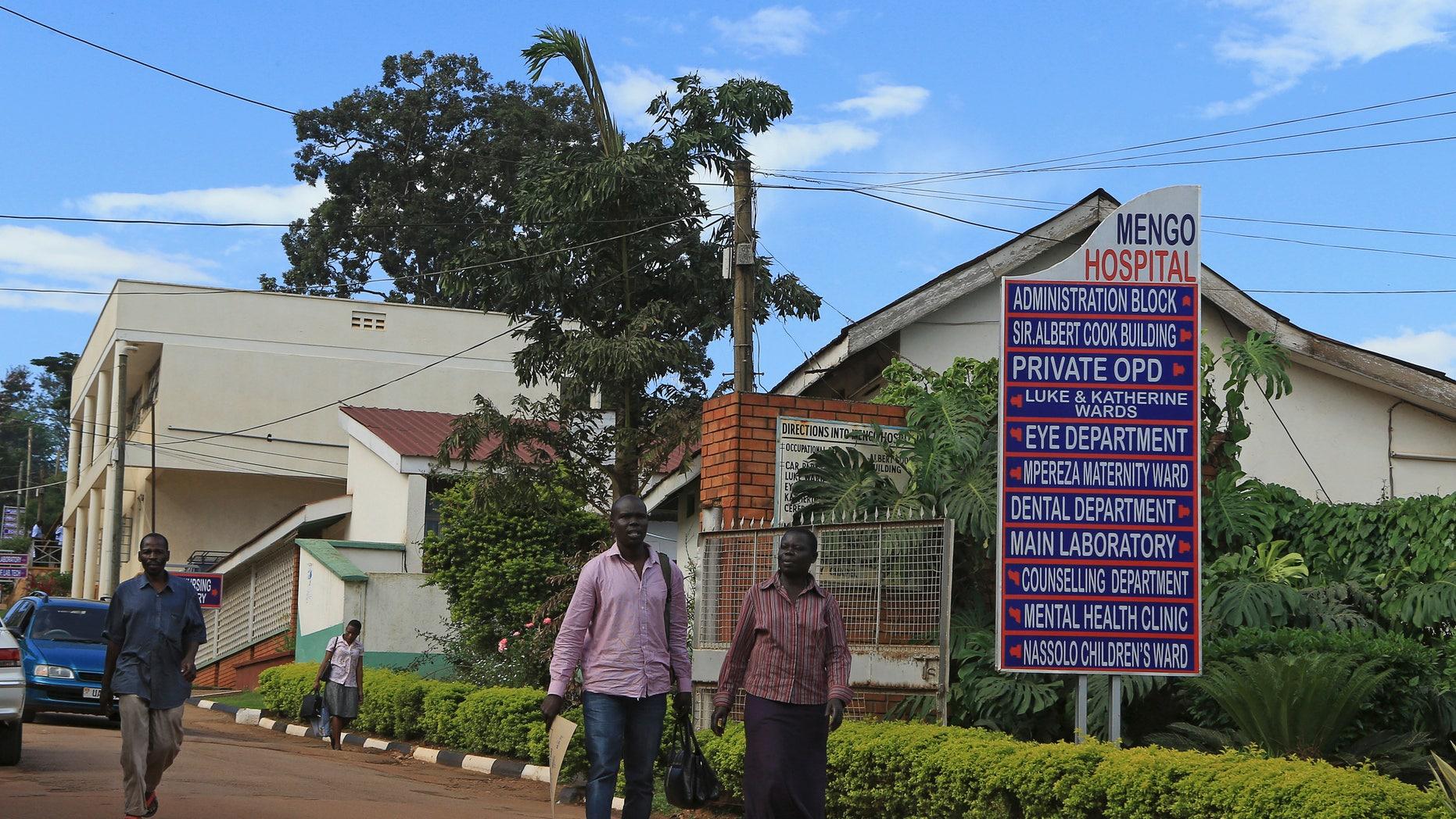 People walk in Mengo Hospital, where an employee died from the Ebola-like Marburg virus, in the Uganda capital Kampala October 6, 2014. REUTERS/James Akena