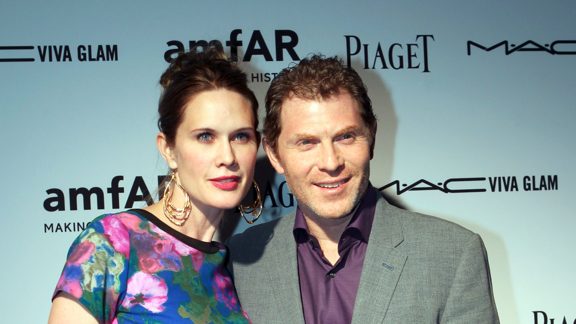 December 6, 2012. Actress Stephanie March and her husband, chef Bobby Flay, attend the amfAR Inspiration Miami Beach Party at Soho Beach House in Miami Beach, Florida.