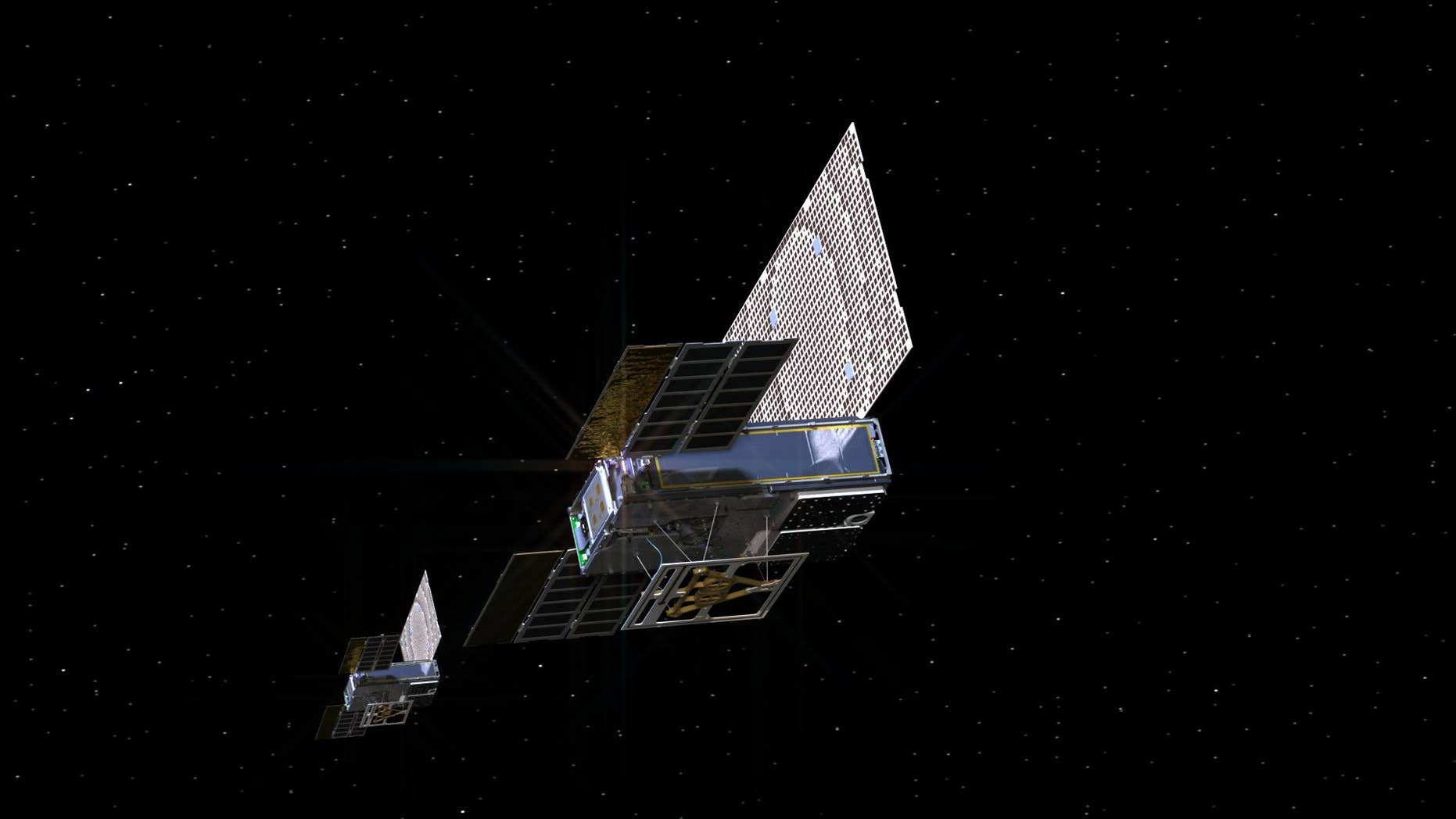 An artist's depiction of the tiny twin MarCO spacecraft on their way to Mars.