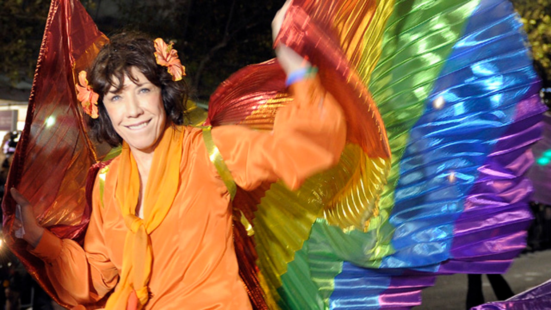 March 5: Hollywood star Lily Tomlin reacts as she takes part in the 2011 Gay and Lesbian Mardi Gras in Sydney, Australia. (AP)