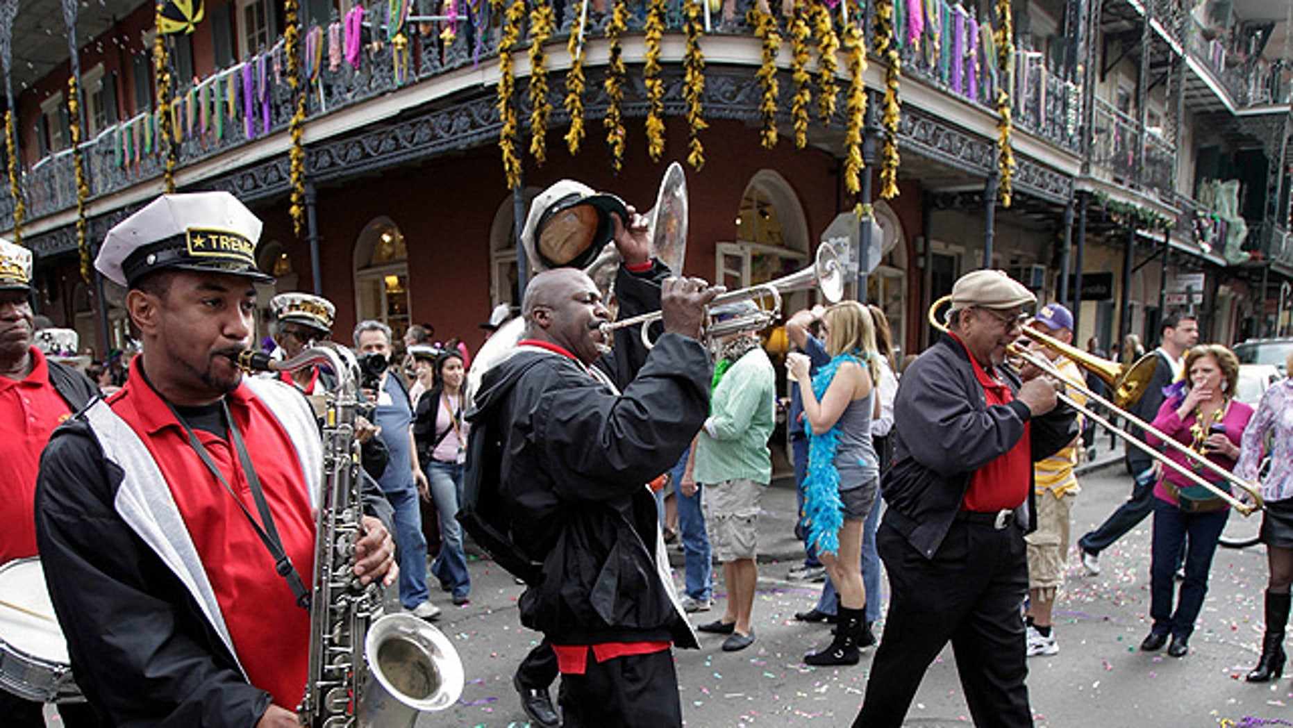 Feb. 21, 2012: Revelers celebrate Mardi Gras in New Orleans' French Quarter, a popular spot for tour guides who say newly-enforced city regulations are trampling their First Amendment rights. (AP)