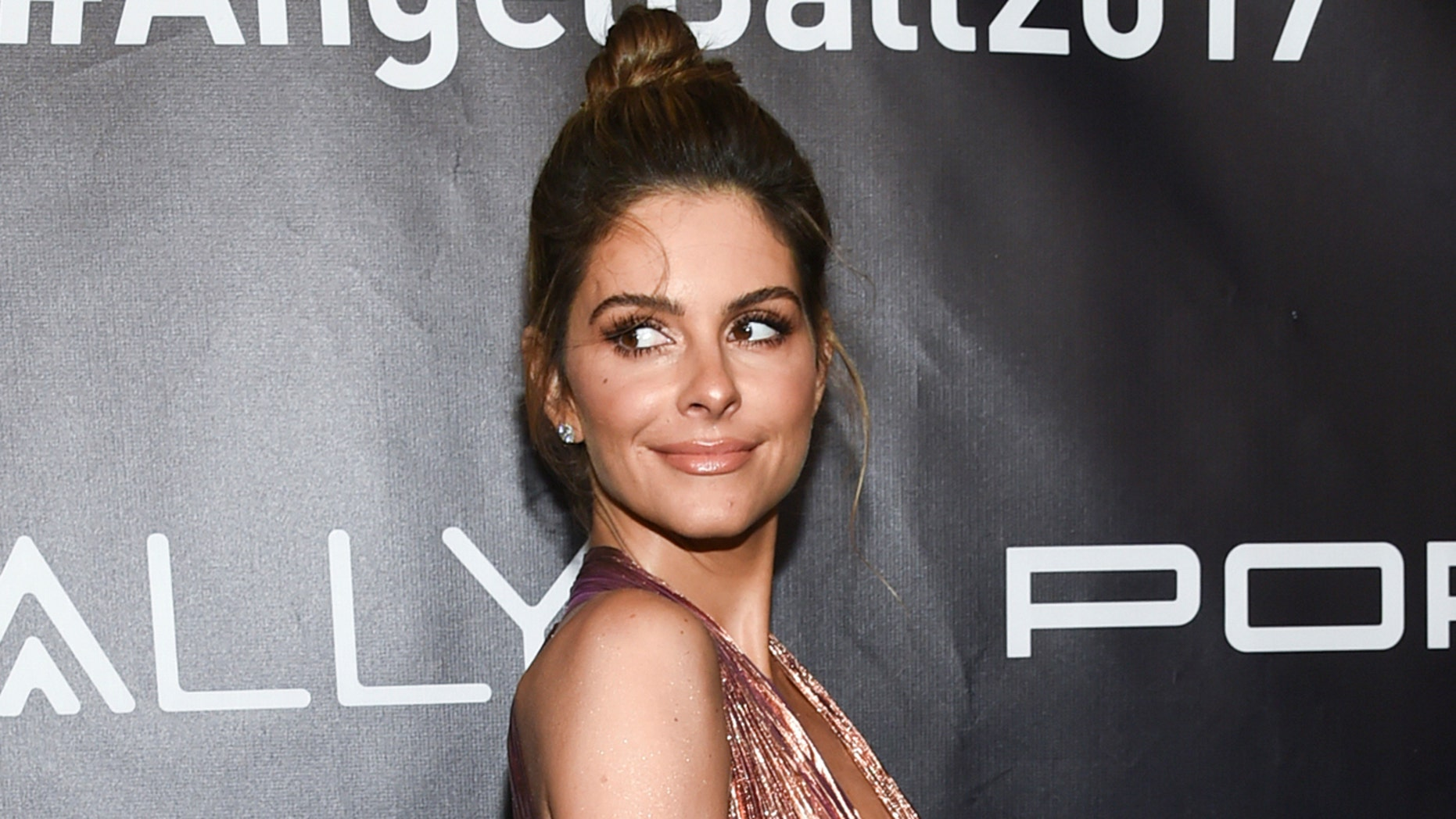 FILE - In this Oct. 23, 2017 file photo, Maria Menounos attends the Angel Ball in New York. Menounos believes in equal pay for equal work, but feels the situation with her former E! News colleague Catt Sadler is a bit more complicated. Sadler left the network late last year after learning that her on-air partner Jason Kennedy made nearly twice as much money as she did. She said she had to take a stand. While sympathetic, Menounos said simply paying everyone the same isn't always feasible. She cited NBA superstar LeBron James, who earns much more than many of his teammates. (Photo by Evan Agostini/Invision/AP, File)
