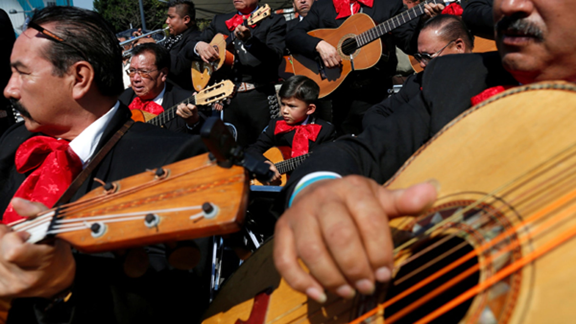 Mexico's police are hoping forming a mariachi band -- like one seen above playing in Mexico City on November 22, 2016 -- will help improve their reputation with countrymen.