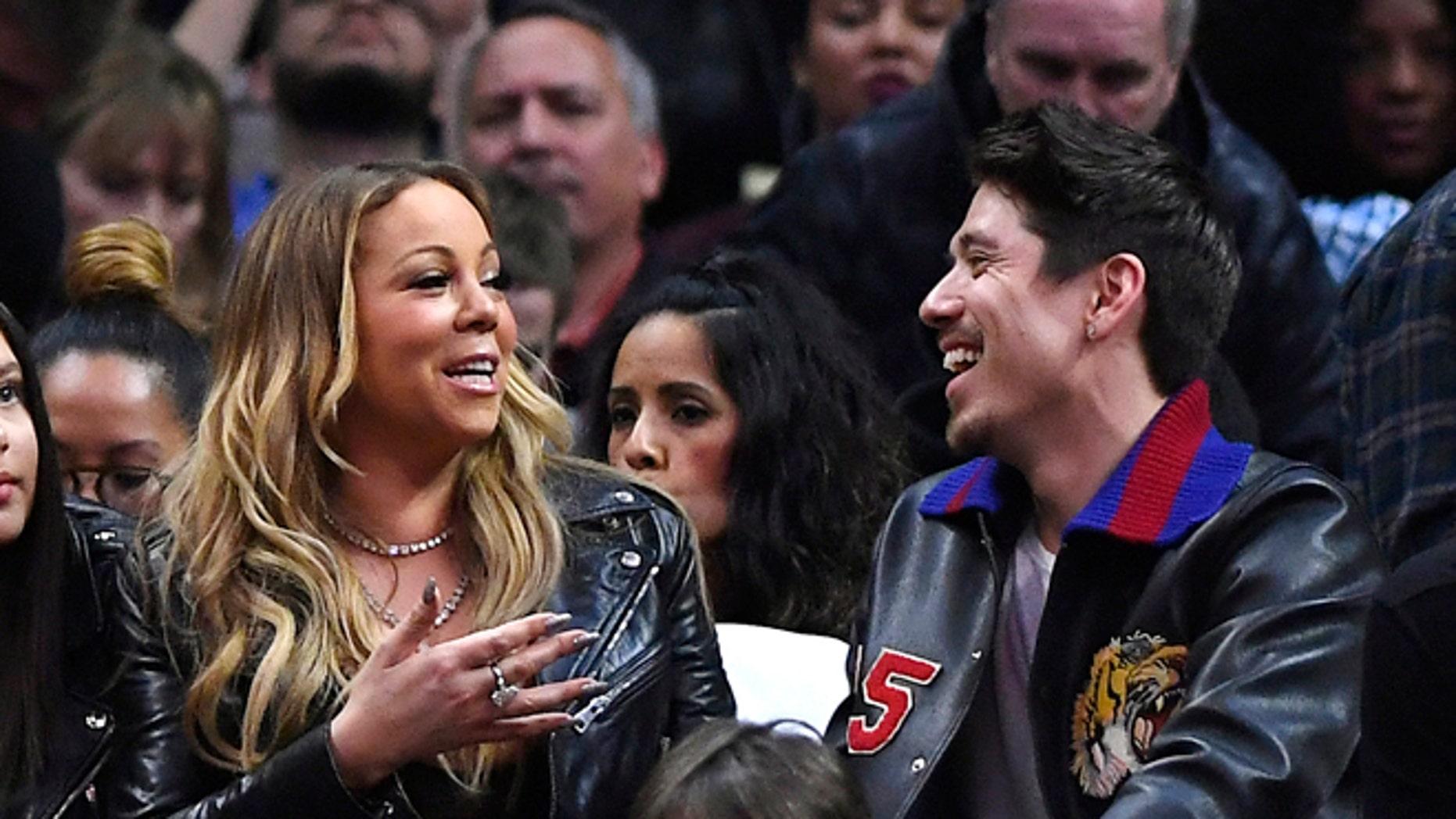 Mariah Carey confirmed she's dating backup dancer Bryan Tanaka.