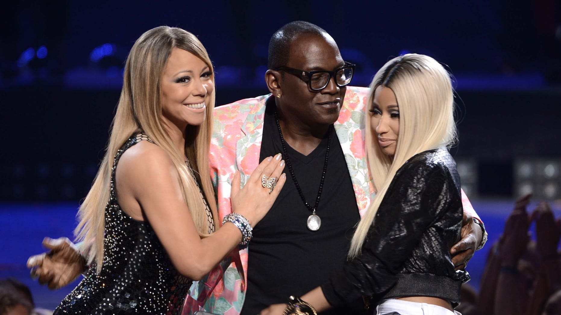 "LOS ANGELES, CA - MAY 16:  (L-R) American Idol judges Mariah Carey, Randy Jackson and Nicki Minaj are seen onstage during Fox's ""American Idol 2013"" Finale Results Show at Nokia Theatre L.A. Live on May 16, 2013 in Los Angeles, California.  (Photo by Kevin Winter/Getty Images)"