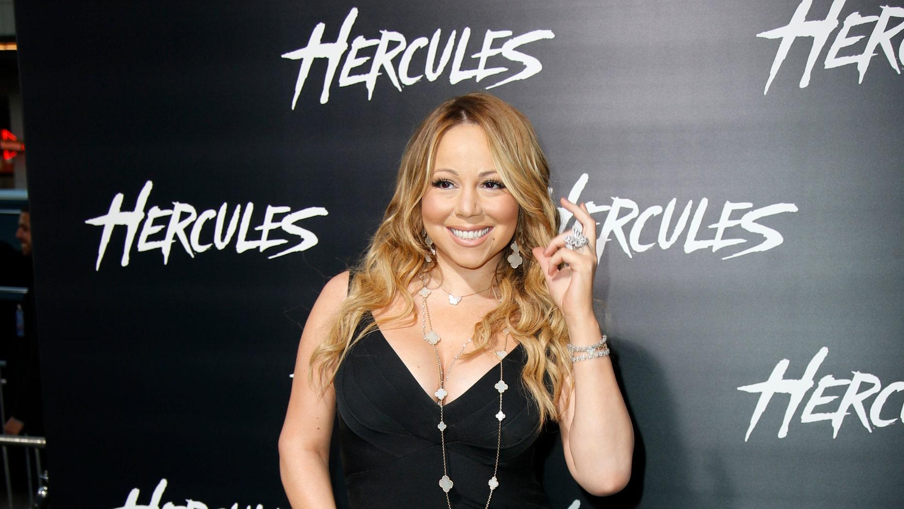 "July 23, 2014. Singer Mariah Carey poses at the Los Angeles premiere of ""Hercules"" in Hollywood, California."